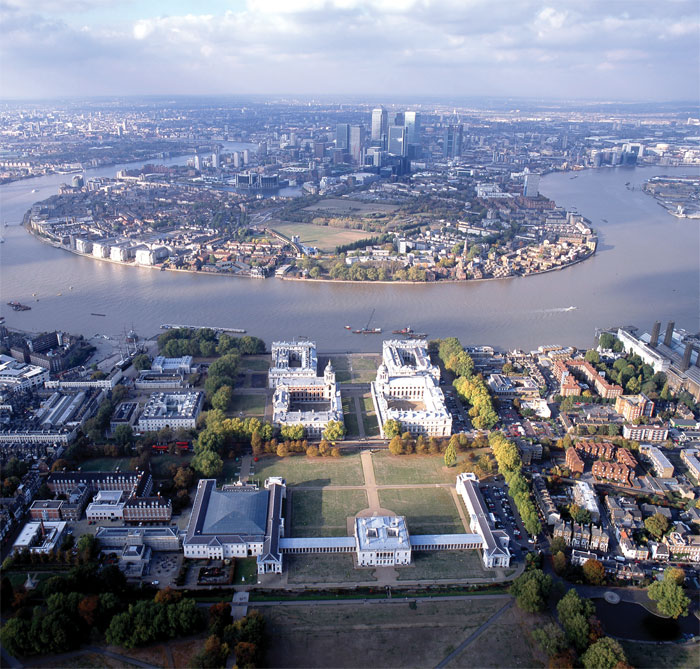 Greenwich World Heritage Site, with the Queen's House in the foreground, and The Old Royal Naval College nearer to the Thames. The Isle of Dogs is across the River, with the skyscrapers of Canary Wharf further to the west.