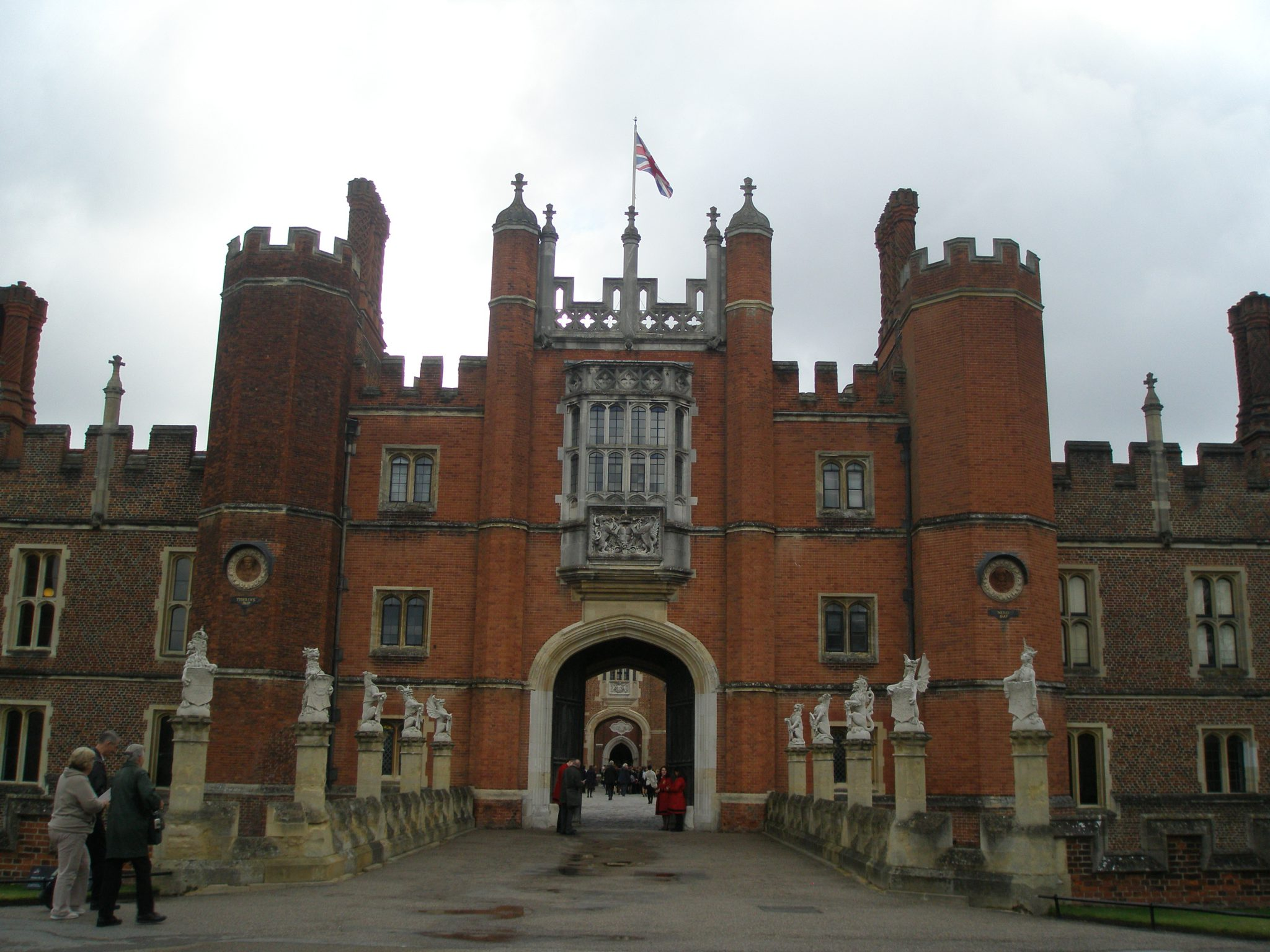 "Main Entrance: Wolsey's Great Gatehouse. Along the moat bridge are statues of his ""King's Beasts."""