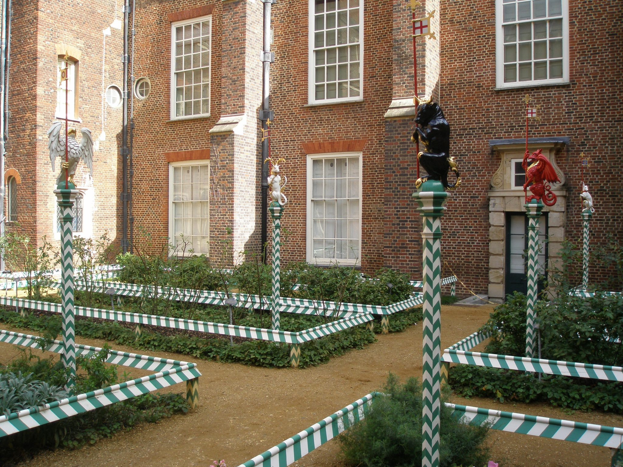 Chapel Court Garden, with low rails in the Tudor colors of white & green. Period plantings of primroses, strawberries & violets are still maintained. Henry created this garden in the 1530's.