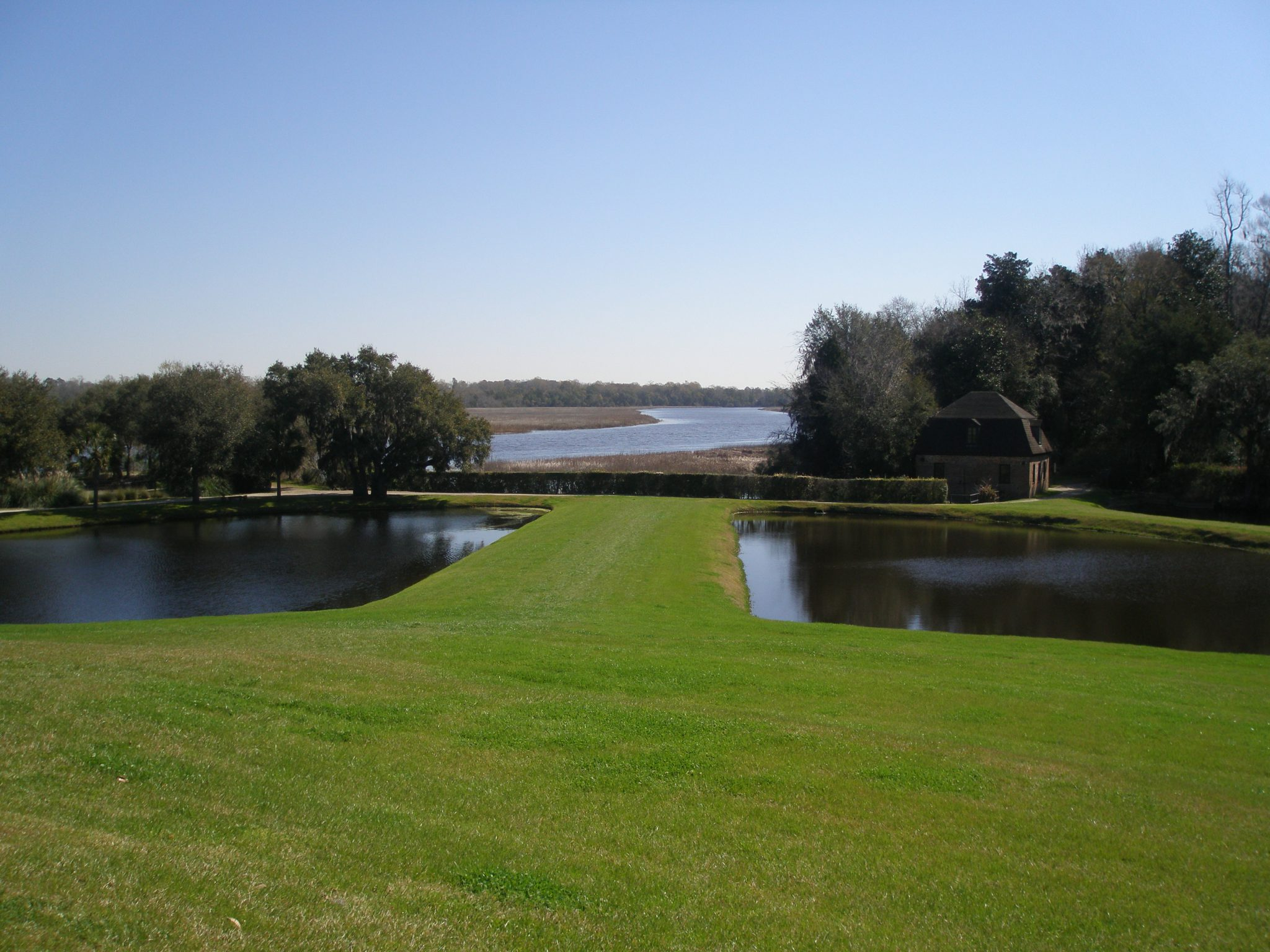 View eastward, away from the site of the Main House, between the Butterfly Lakes, and on to the Ashley River.