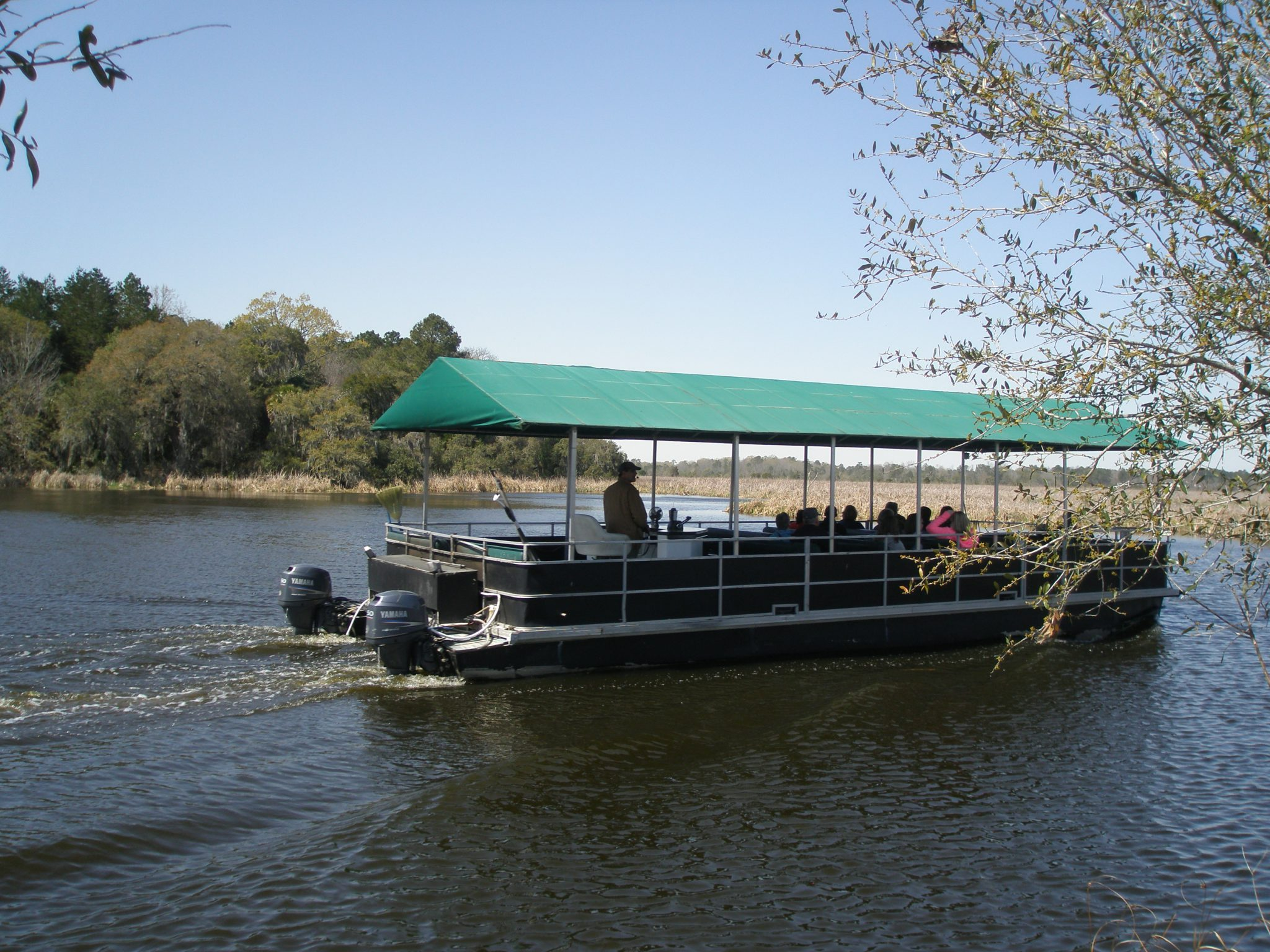 The Spell is temporarily broken as a Nature Tour boat chugs past.