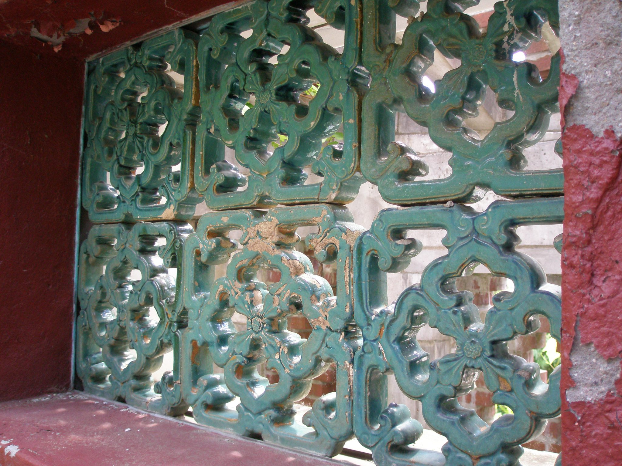 From inside the Chinese Garden, one can peer out toward the Western hills through perforations in the masonry.
