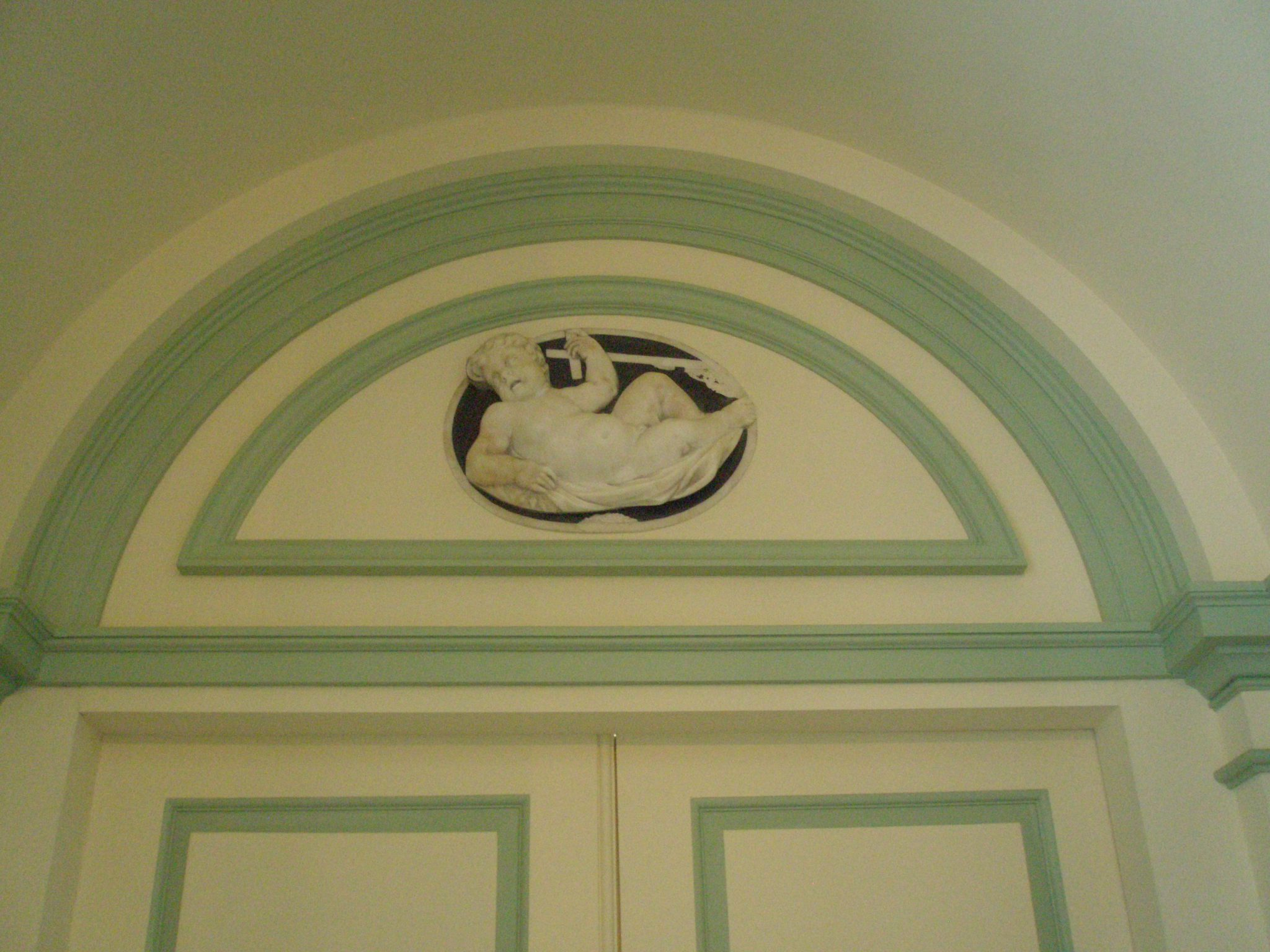 Decoration over the door in the Gallery that leads to the study of Wharton's ineffectual husband, Teddy. Teddy's story is long and depressing...suffice it to say that Edith eventually had to leave him, along with her beloved home. This bas relief depicts John the Baptist as in infant.