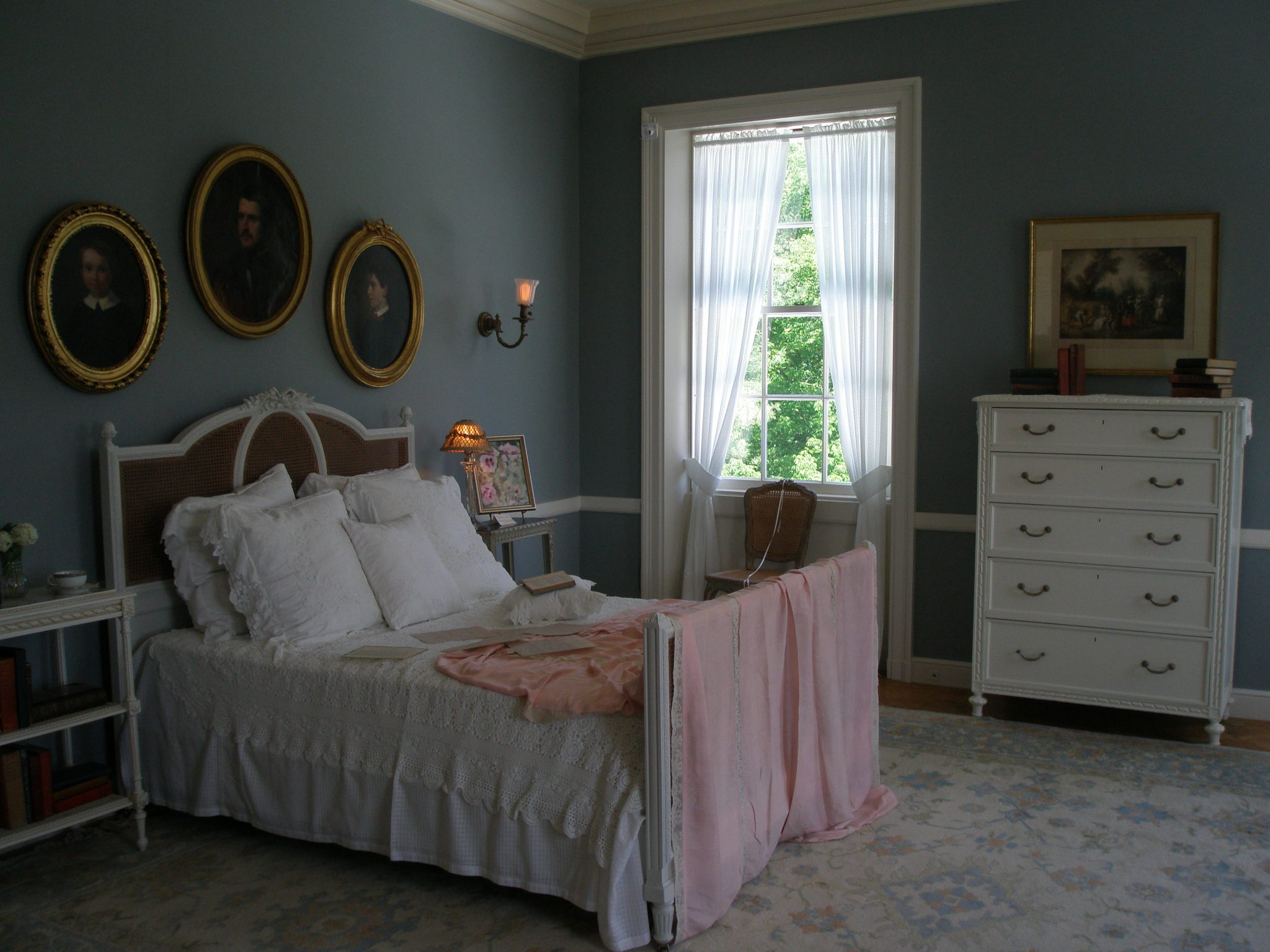 "Edith Wharton's Bedroom. Wharton did most of her writing in this room; she would awaken early and write in bed, dropping the finished pages to the floor, where her secretary would eventually collect them. The Bedroom furnishings we see today are not originals...no one alive knows exactly what this room looked like during Edith's tenure at The Mount. Interior decorators have followed the design rules in ""The Decoration Houses,"" and are confident that the rather spare appearance of the room is in keeping with Wharton's design approach."