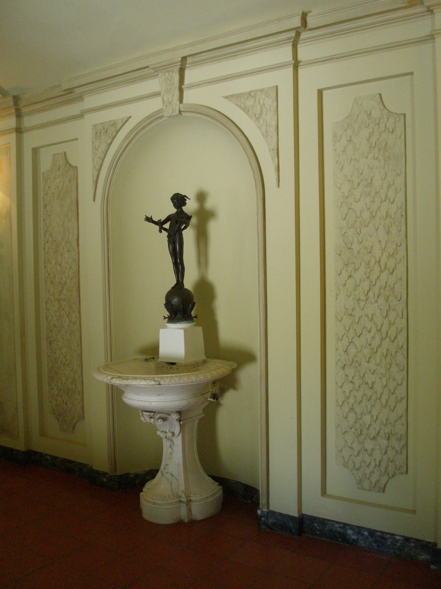 Marble fountain with bronze statue of Pan in Entrance Hall