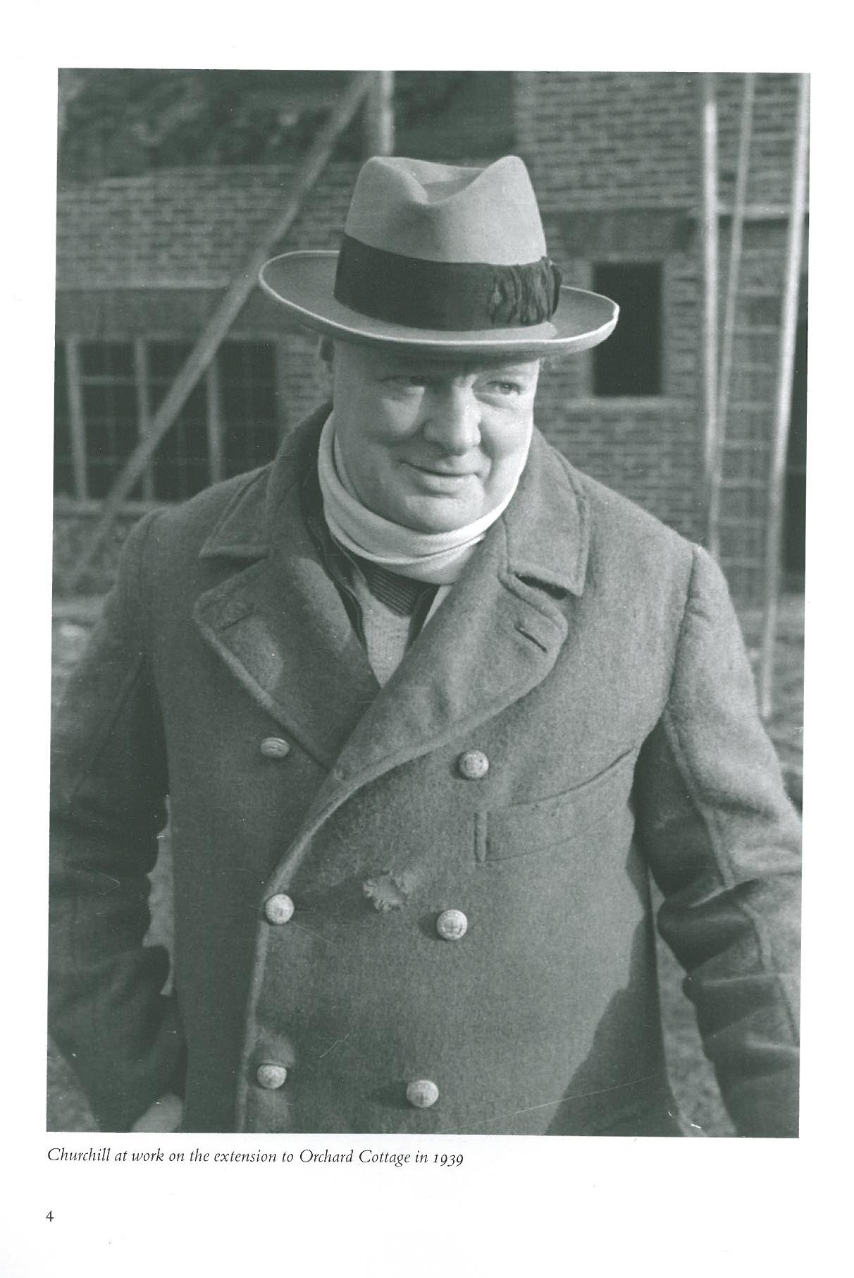 Winston Churchill in 1939. In the background, exterior renovations of Chartwell are underway. Image courtesy of The National Trust.