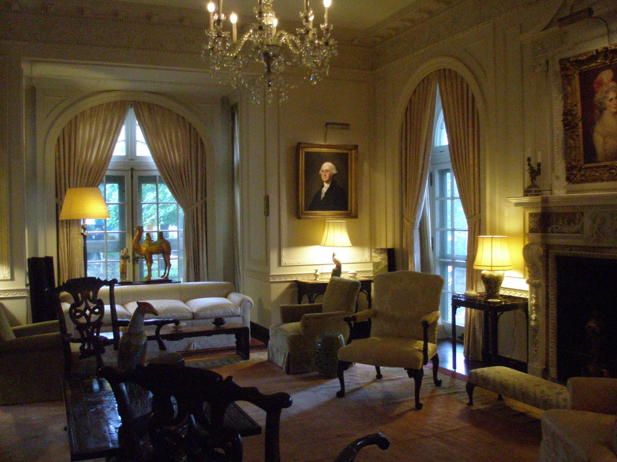 Library. Portrait of George Washington by Gilbert Stuart. I think the camel by the french doors is fabulous!