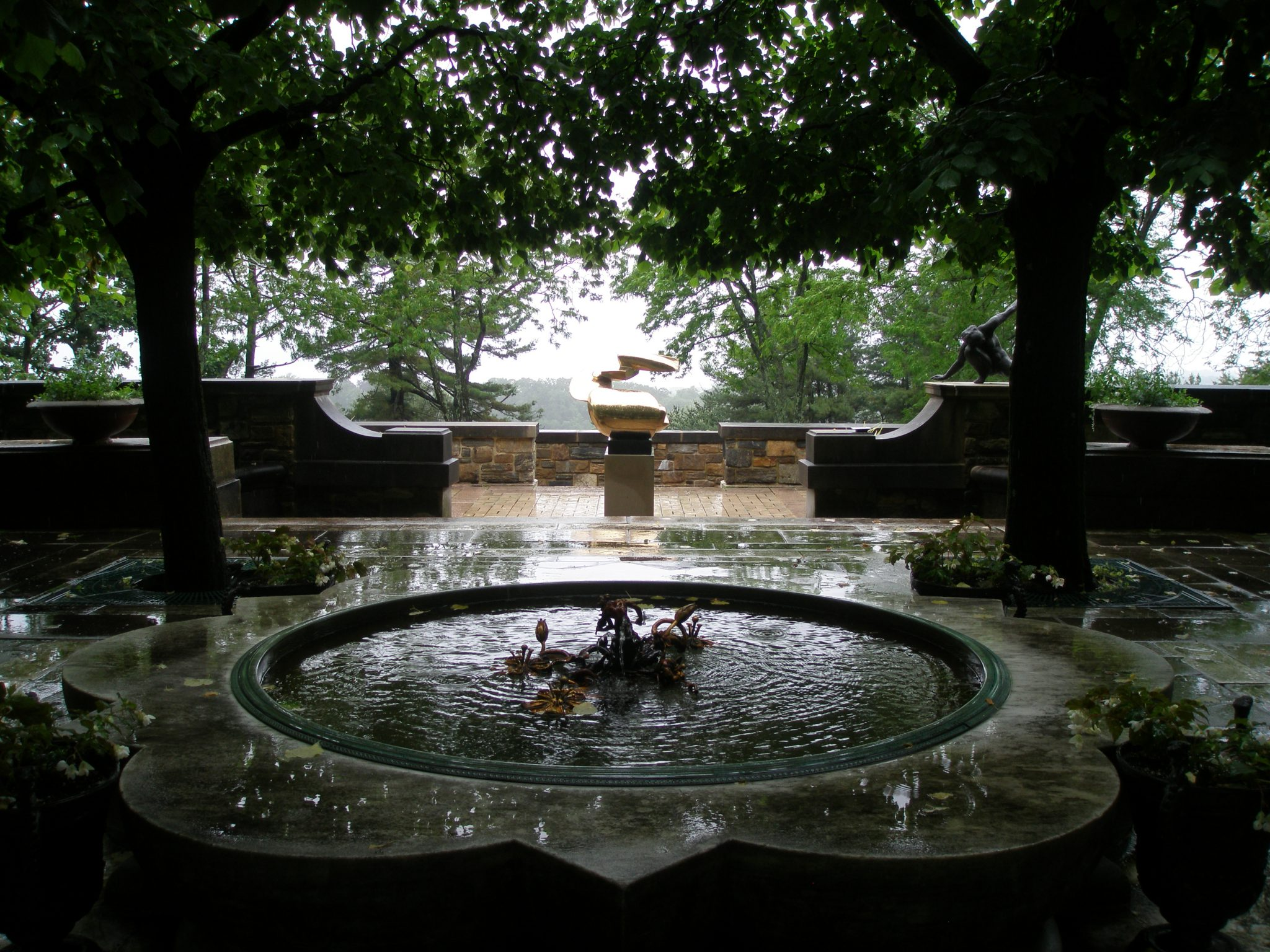 A Pool and Fountain, are set, mid-way along the Linden Allee. On the west terrace, the polished bronze of Peter Chinni's NATURA EXTENSE (1965) shines, even on an overcast day.