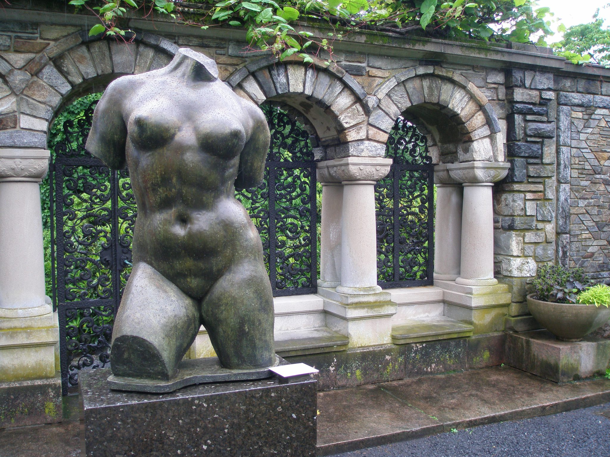 Statue, in from the the grilled wall that separates the Inner Garden from the Brook Garden