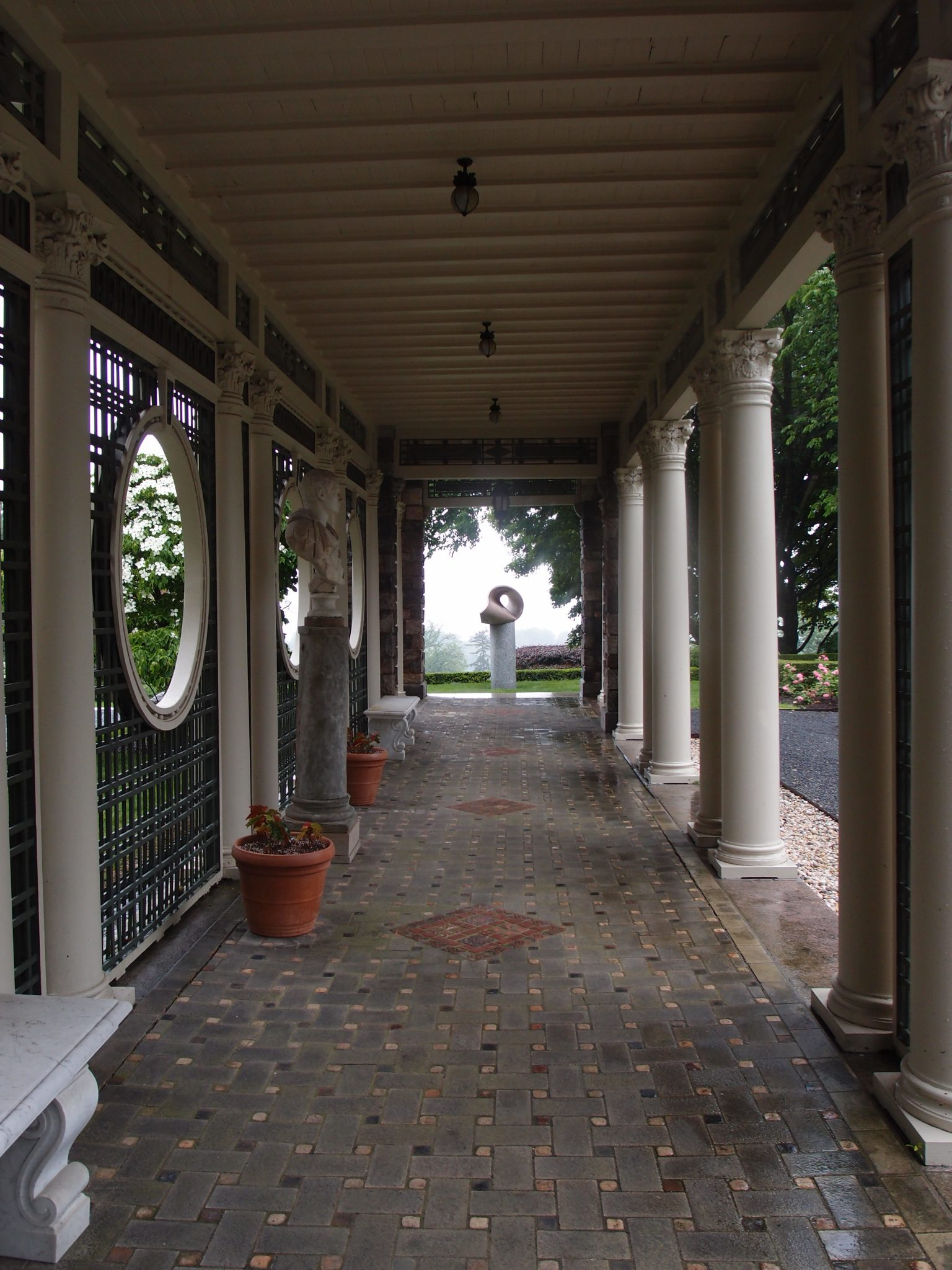 Max Bill's TRIANGULAR SURFACE IN SPACE (1962) is mounted at the west end of the Rose Garden Loggia