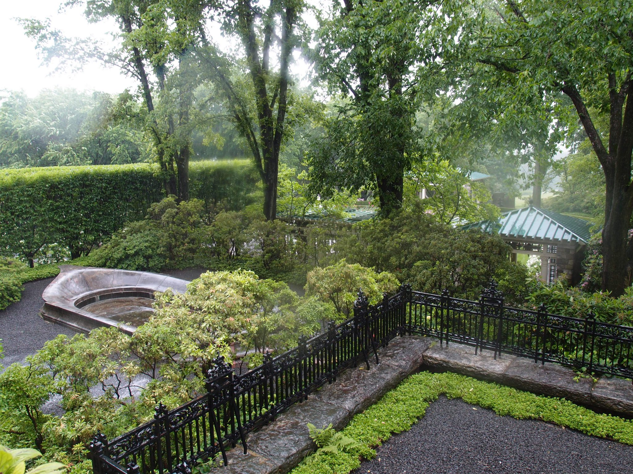On the northeast corner of the West Porch: a view of the green roofs of the gazebos in the Rose Garden.