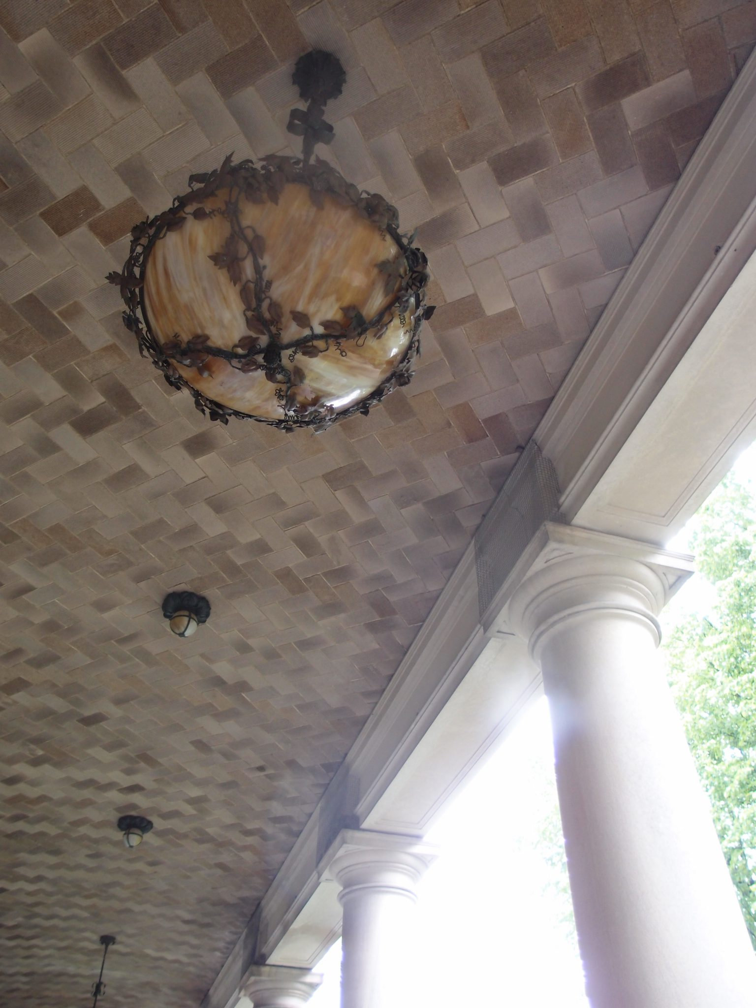 Ceiling tiles and Tiffany glass lamps in the Front Entry Loggia