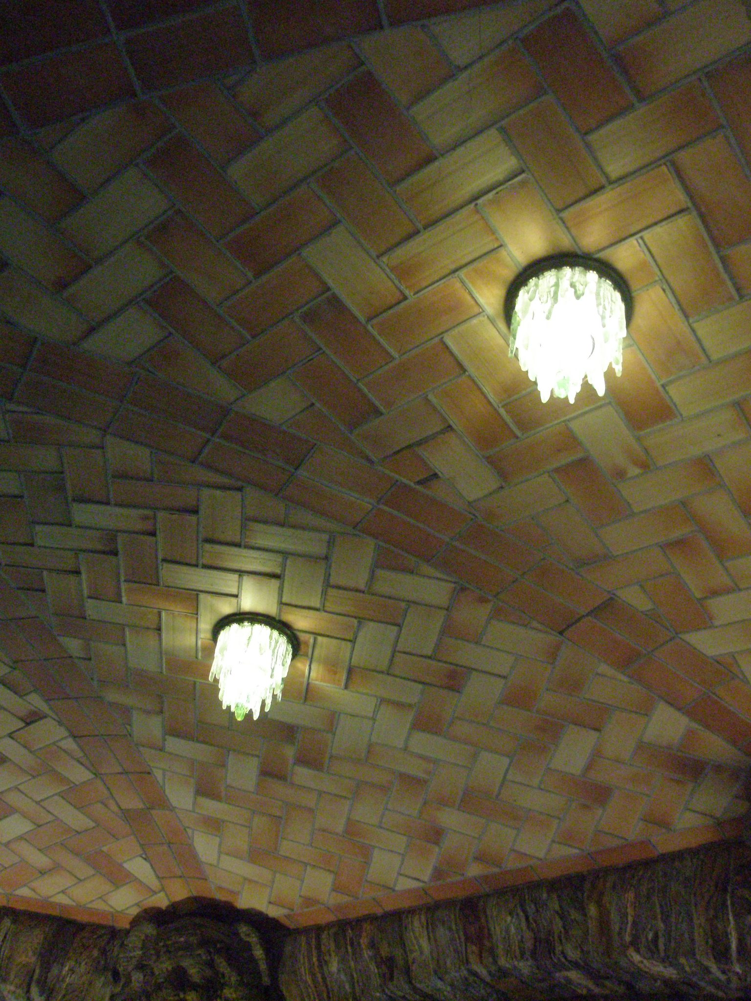 Icicle-form Lights of frosted glass, designed by William Bosworth and made my Tiffany. Guastavino's arched, structural-tile ceiling may look familiar to you: he also did the ceilings in the concourses of Grand Central Station.
