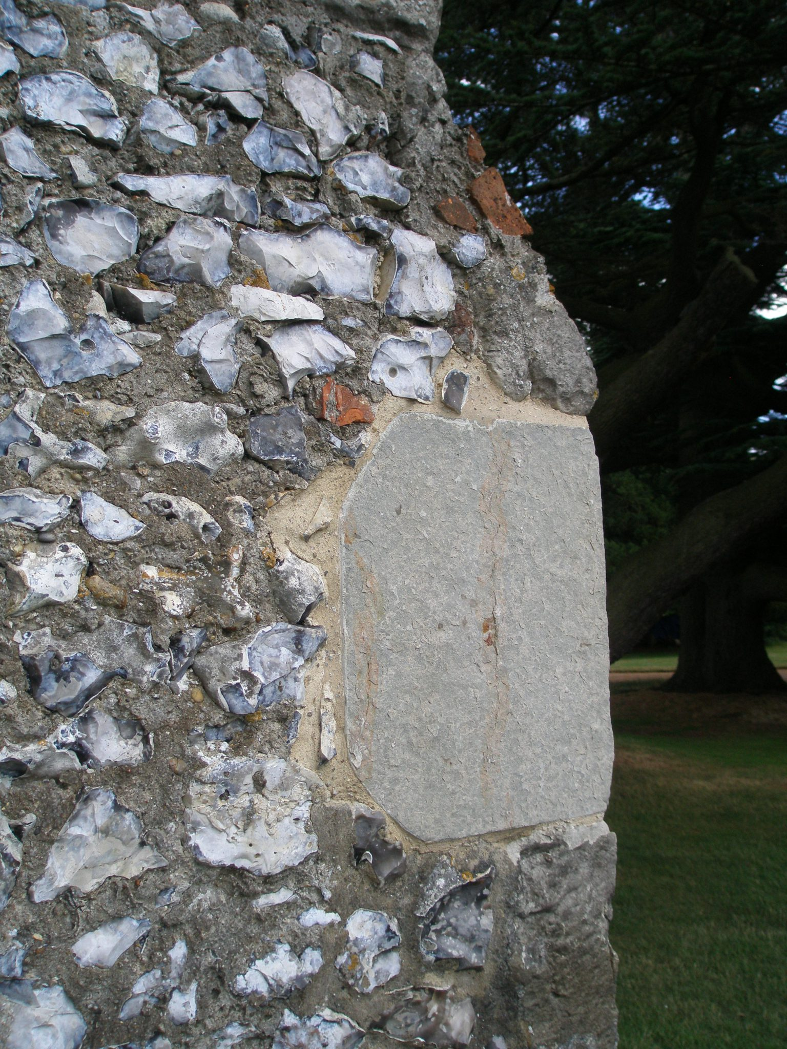 Detail of wall made with flintstone fillers, at back corner of Chapel.