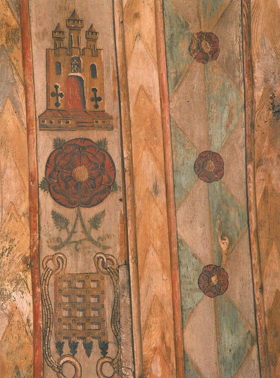 The early 16th century Painted Ceiling of the New Chapel is decorated to honor the Rich and Powerful of the Land: with the Tudor red rose, the Beaufort portcullis of Henry VIII's grandmother, and the castle of Castille for his first wife, Catherine of Aragon. Image courtesy of The National Trust.