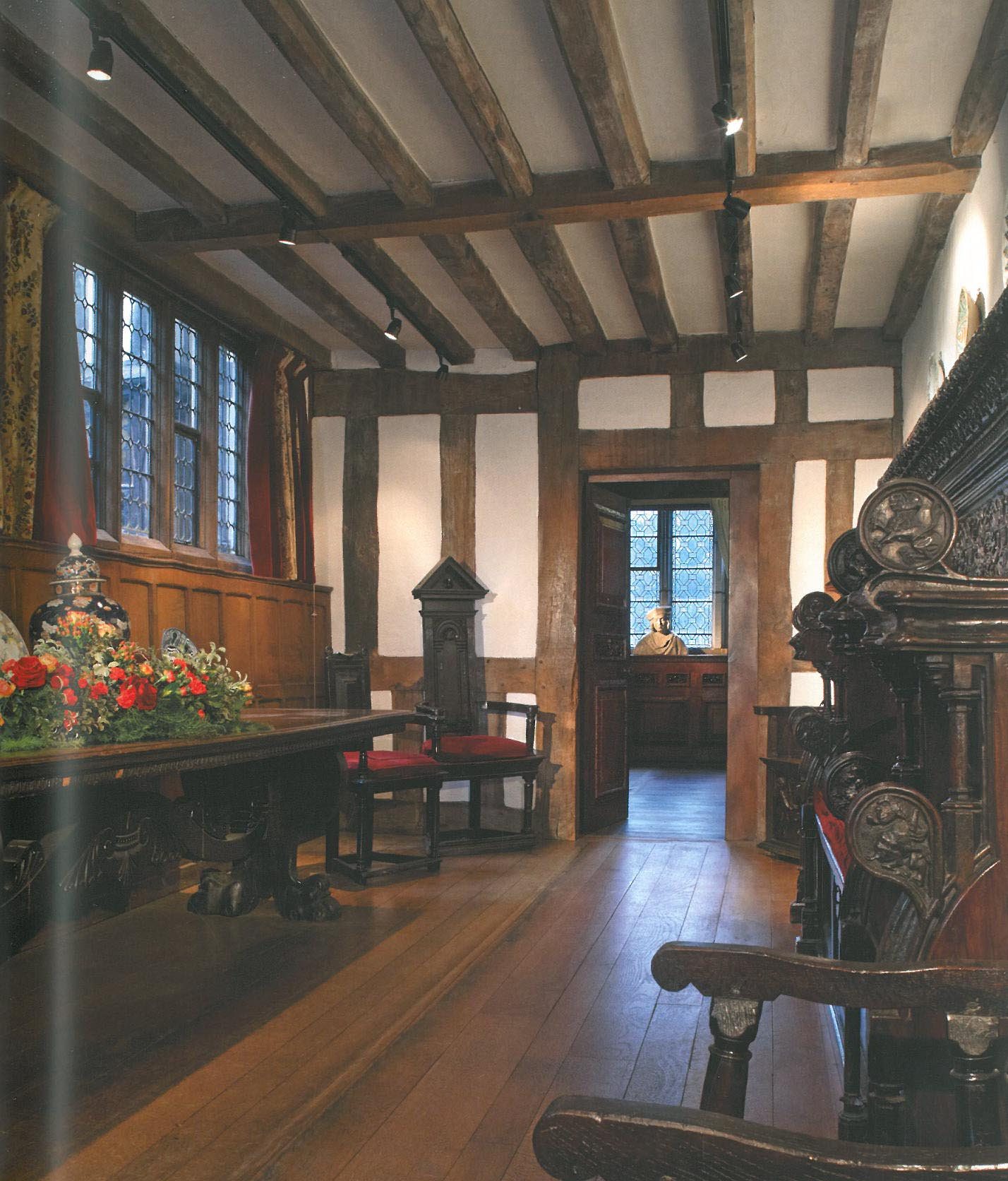 The Entrance Hall to Hever Castle. This was added to the Tudor manor house in 1506 by Thomas Bullen, Anne's father. Thomas, First Earl of Wilshire, and later Earl of Ormond, was a gifted linguist and a trusted diplomat. The furnishings that today adorn the space include a 1480 choir stall (on the right), and a 1565 Italian refectory table (on the left). Image courtesy of Hever Castle.
