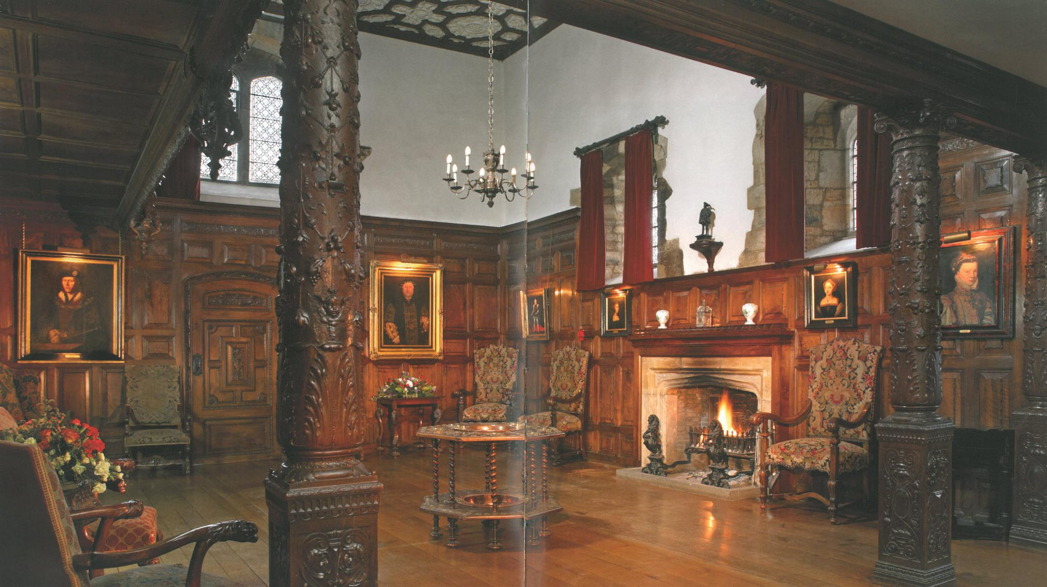 The Inner Hall. The splendor of the reception room that greets visitors to Hever today is a complete contrast to its original use in Tudor times, when this was the Great Kitchen, complete with a large fireplace for cooking and a well for water. Between 1903 and 1908, William Waldorf Astor redid the space with Italian walnut paneling and columns. Image courtesy of Hever Castle.