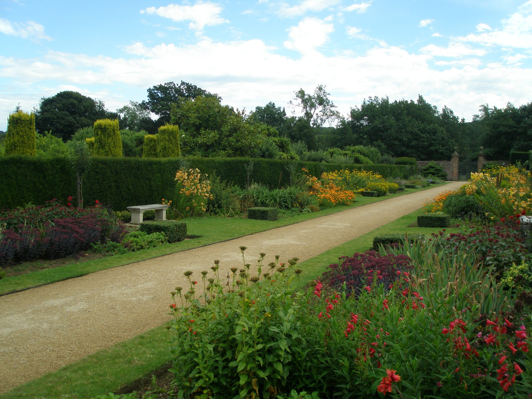 The Jubilee Walk was added to the gardens in 2012, and designed by George Carter, a RHS Chelsea Flower Show Gold Medallist. The Walk is 236 feet long, and planted as a double herbaceous border, with each of the five bays planted in a dominant color, the sequence moving from red through orange, yellow, and pink to blue.