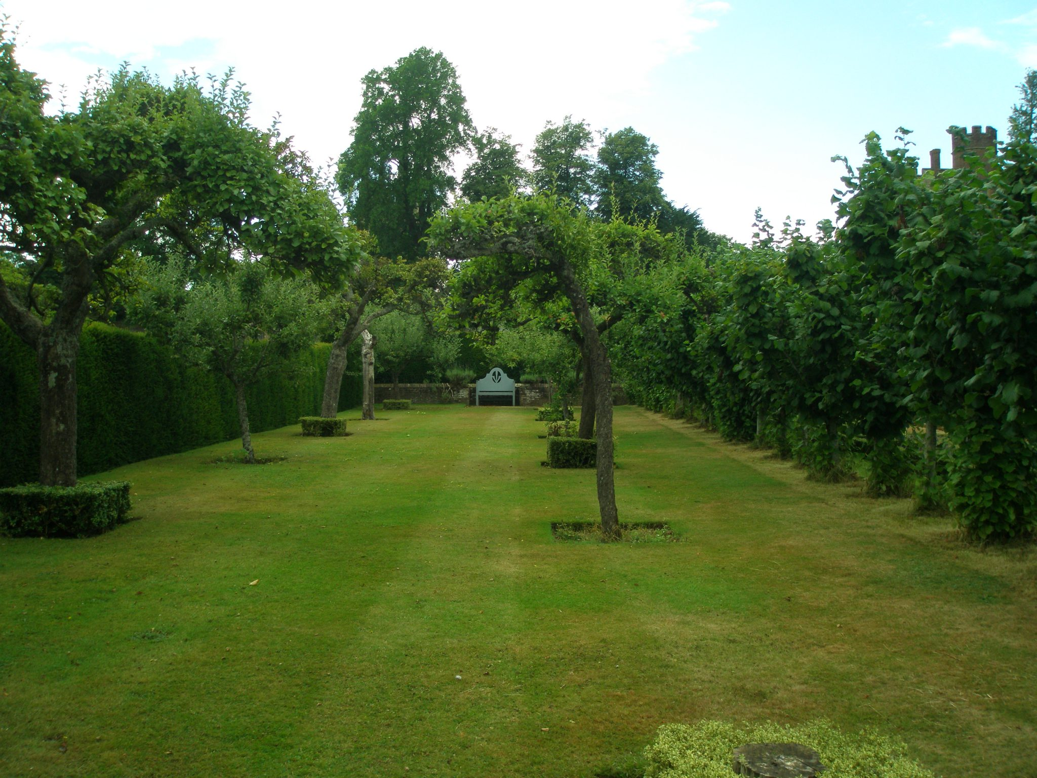 Serene swathes of green flank the Heraldic Garden