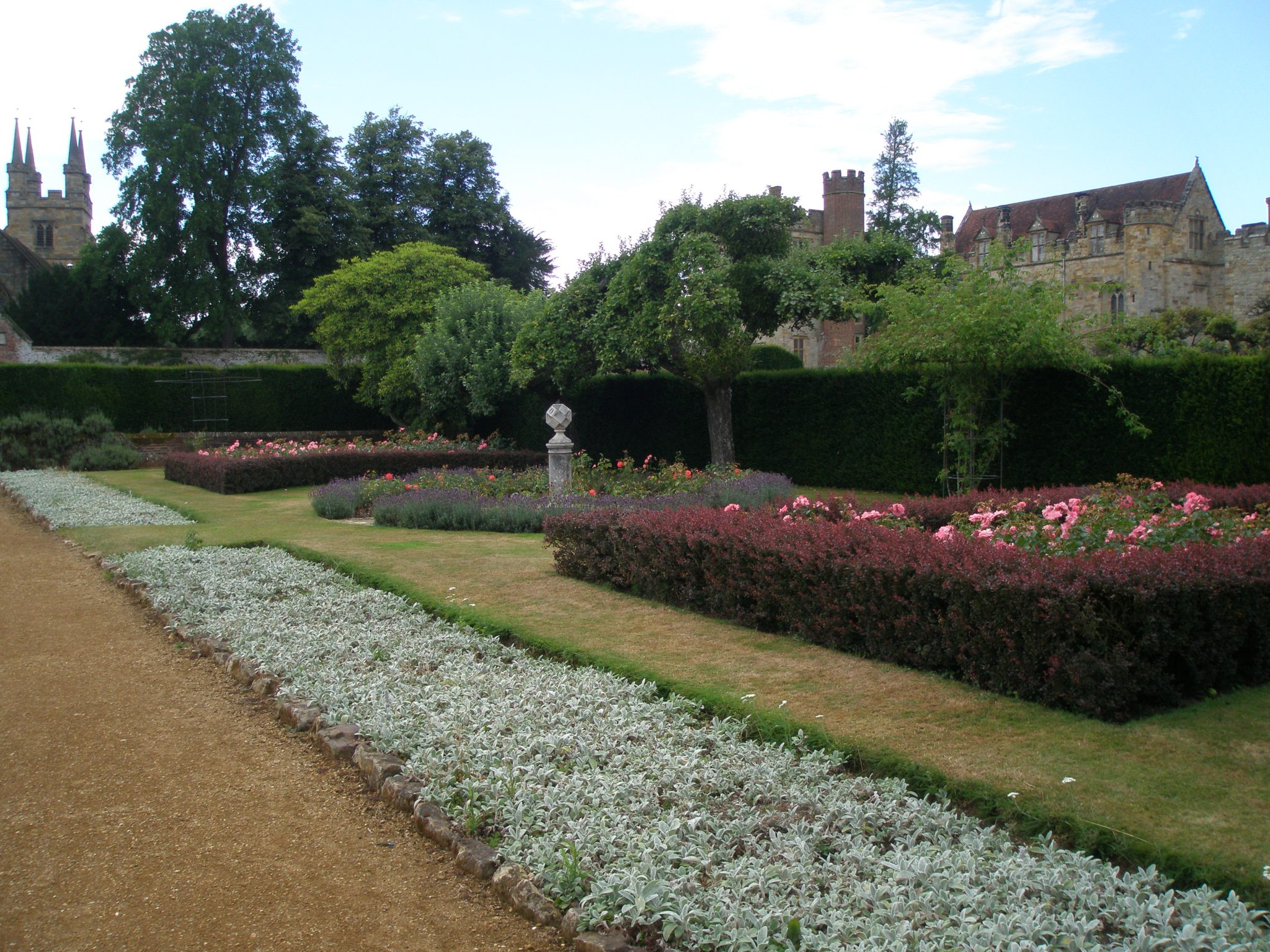 Another view of the Rose Garden, with church to the left, and the House to the right.