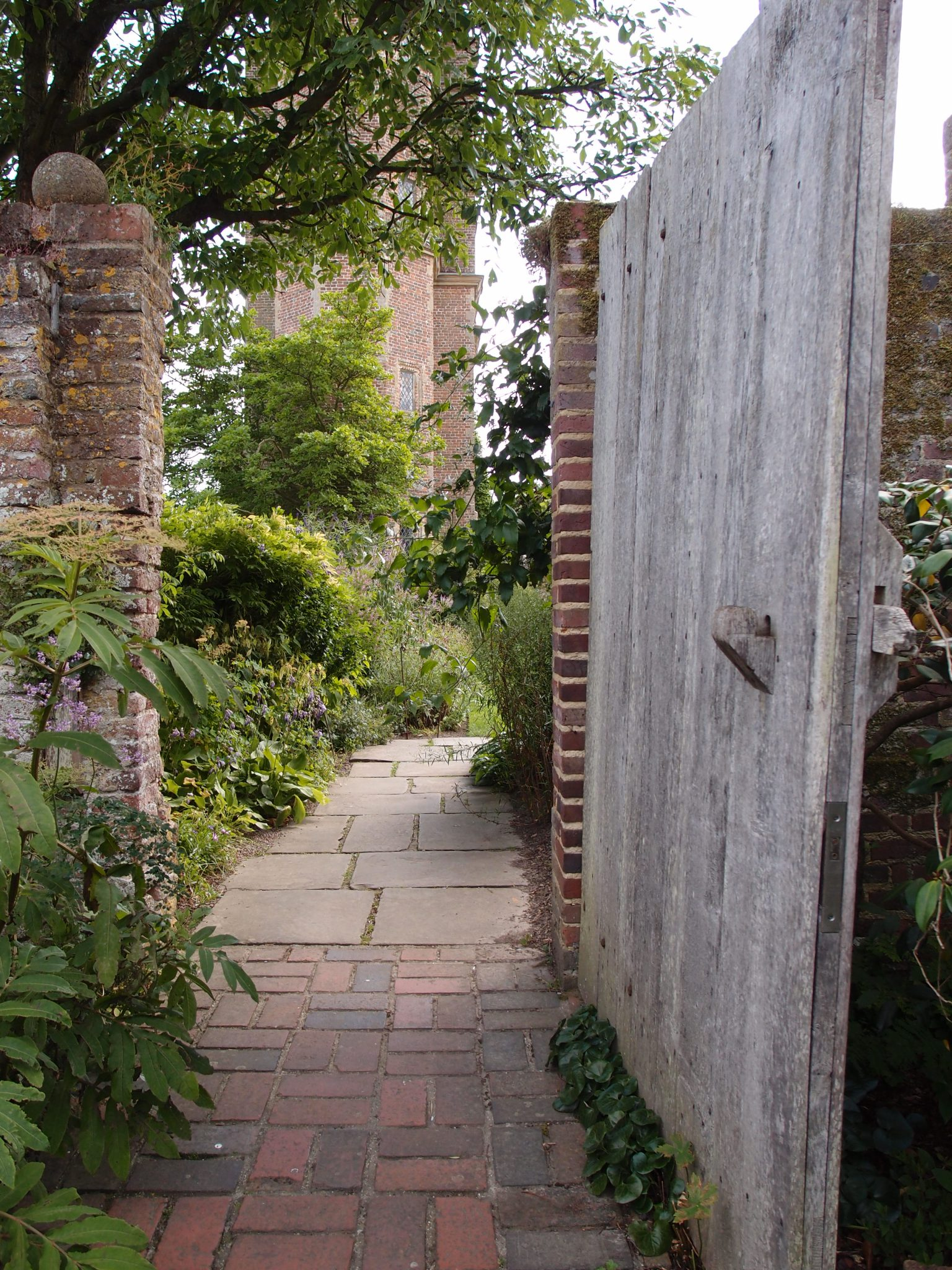 We leave the White Garden through the Bishop's Gate, then turn right, and head toward the Top Courtyard's Purple Border.