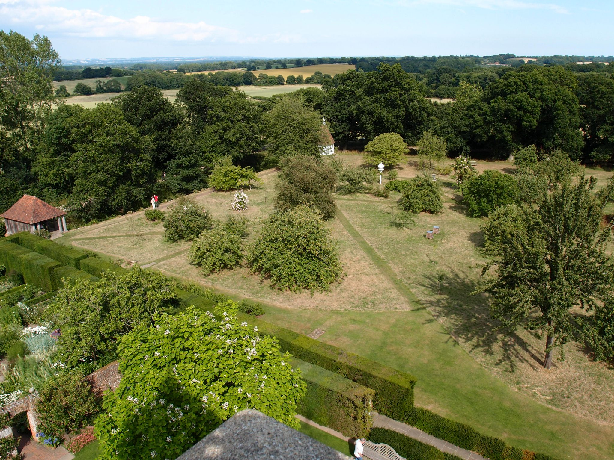 Looking Northeast. The Orchard, with the Gazebo at the farthest corner. The tall, double hedges of the Yew Walk are directly below the Tower.