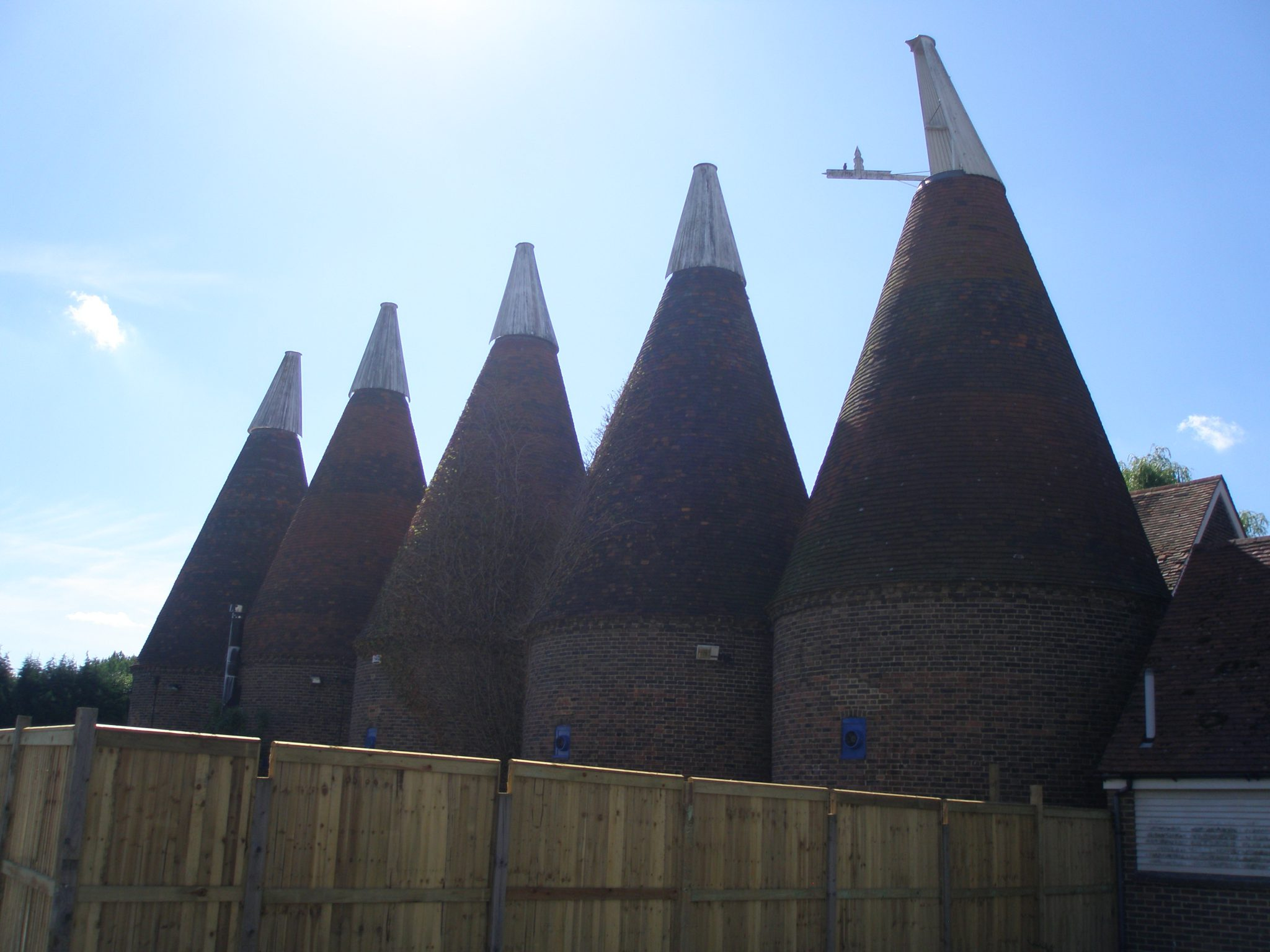 Five Oast roofs