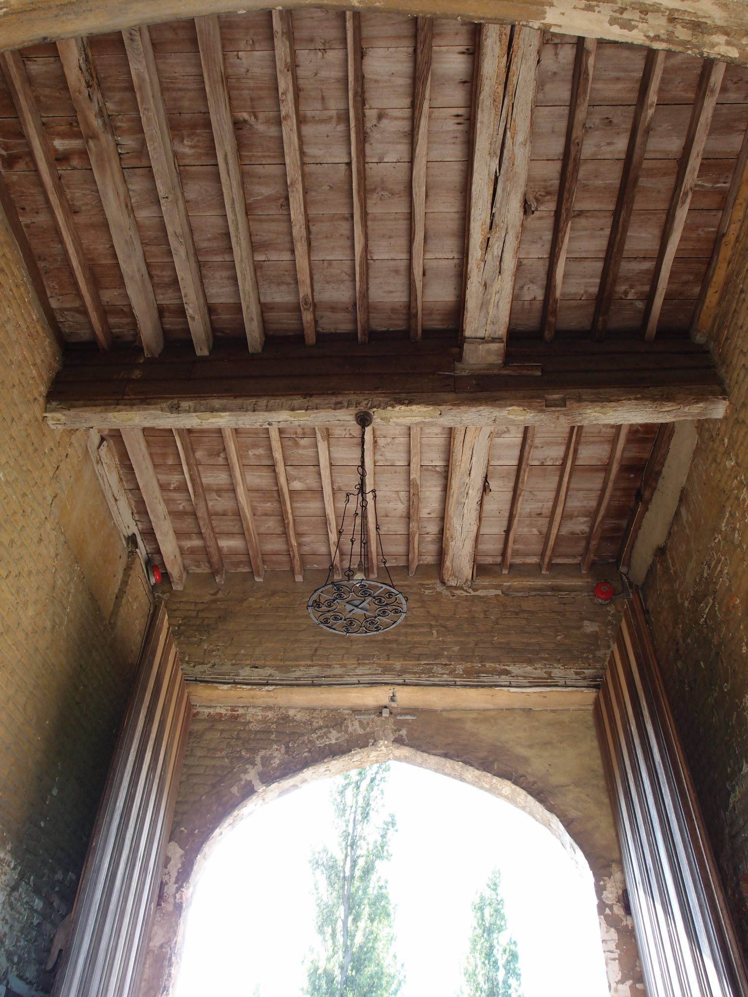 Detail of overhead beams, dating from 1530, in the tunnel through the Main House