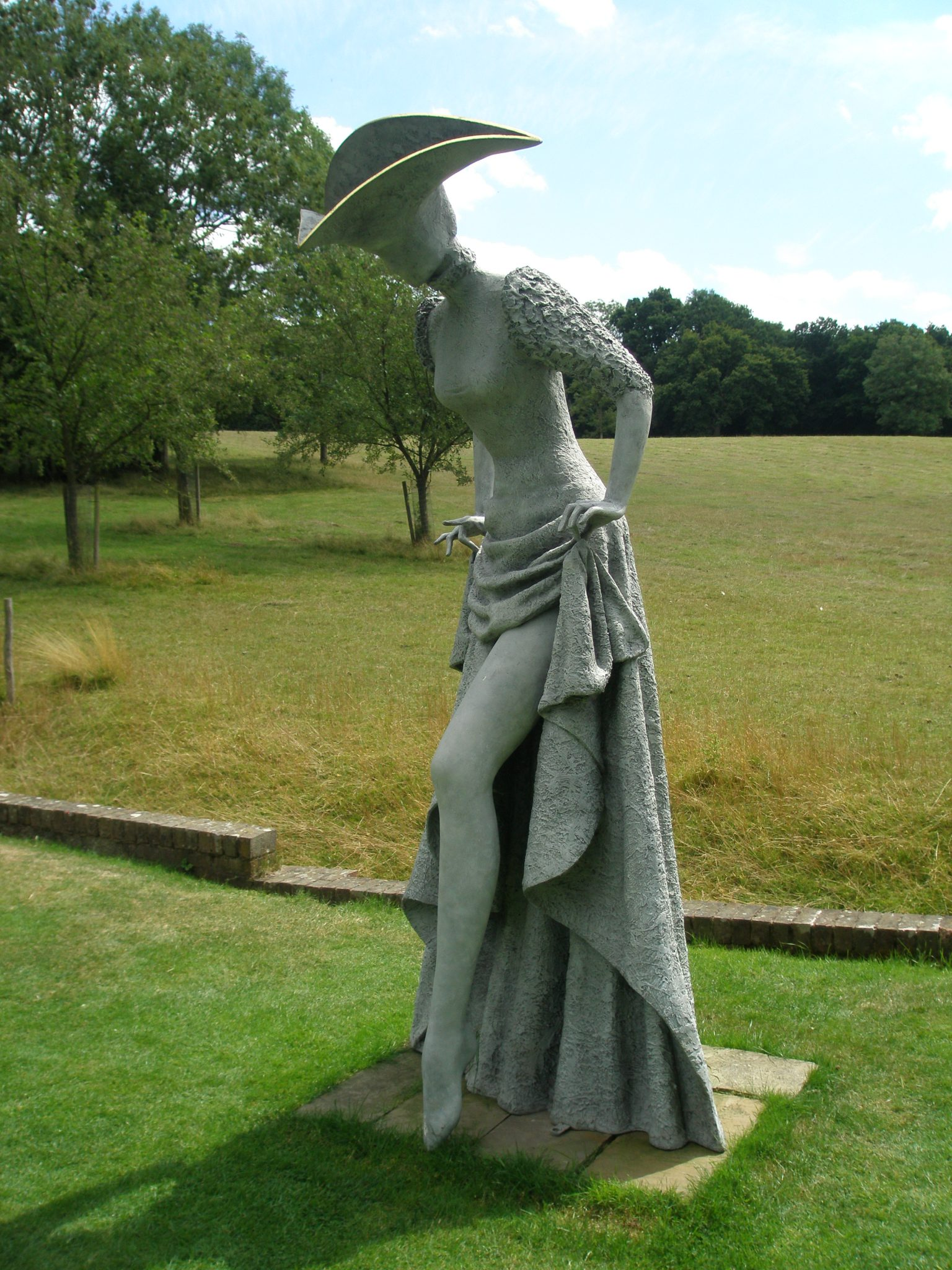 At the base of the central path through the Herbaceous Border, this 8-foot-tall Lady exposes a shapely leg. Behind her is a Ha-Ha ditch, which keeps Pashey's flocks of sheep in their fields, and out of the Gardens