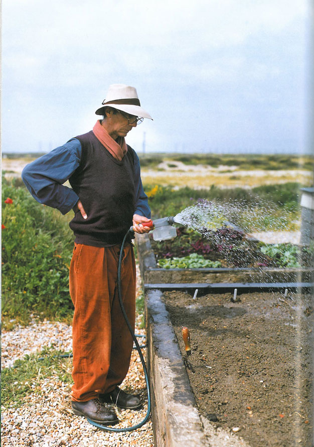 Jarman watering in the seeds in his raised beds, where he grew herbs and vegetables. Image courtesy of Estate of Derek Jarman.