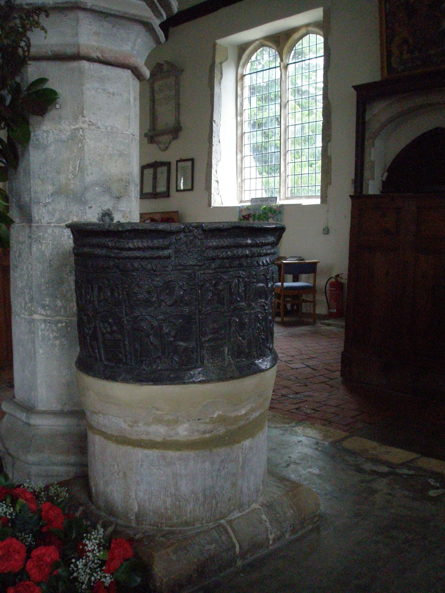 The round, lead Font dates from the 12th century.