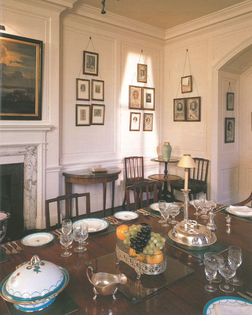 Todays visitors to Walmer Castle see the Dining Room, just as it was used by the late Lord Warden, HM the Queen Mother. The celeste blue Minton service on the table was the one which the Queen Mother kept at the Castle. The dining table and set of thirteen mahogany chairs belonged to William Pitt. The large collection of prints provides portraits of most of the Lords Warden. Image courtesy of Walmer Castle.