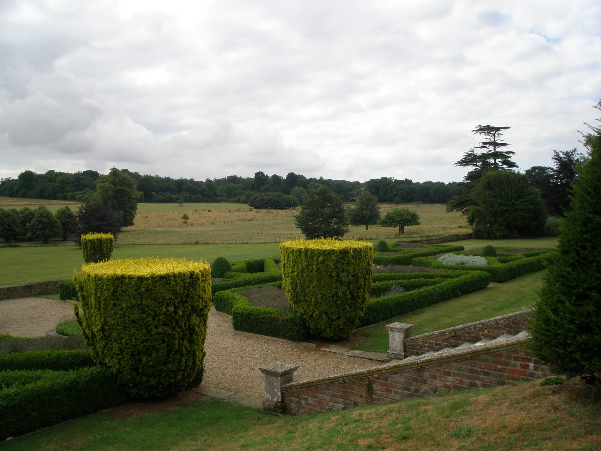 From the East Face's Upper Terrace, one has long views over the Parterre, and then farther off, of meadows filled with grazing cattle and sheep.