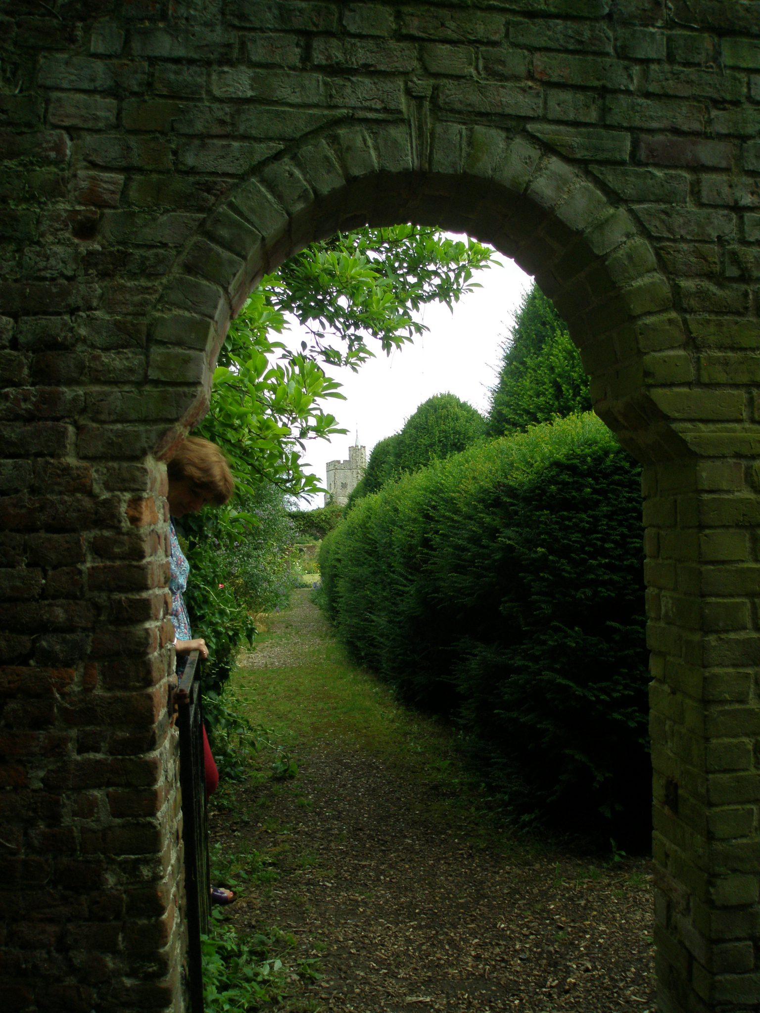 Nearby the Cedar of Lebanon is this archway, which leads to the Walled Garden. Amanda held open the gate, and smiled her little-cat-smile, as she waited to see my reaction to this glimpse of a distant, church tower.