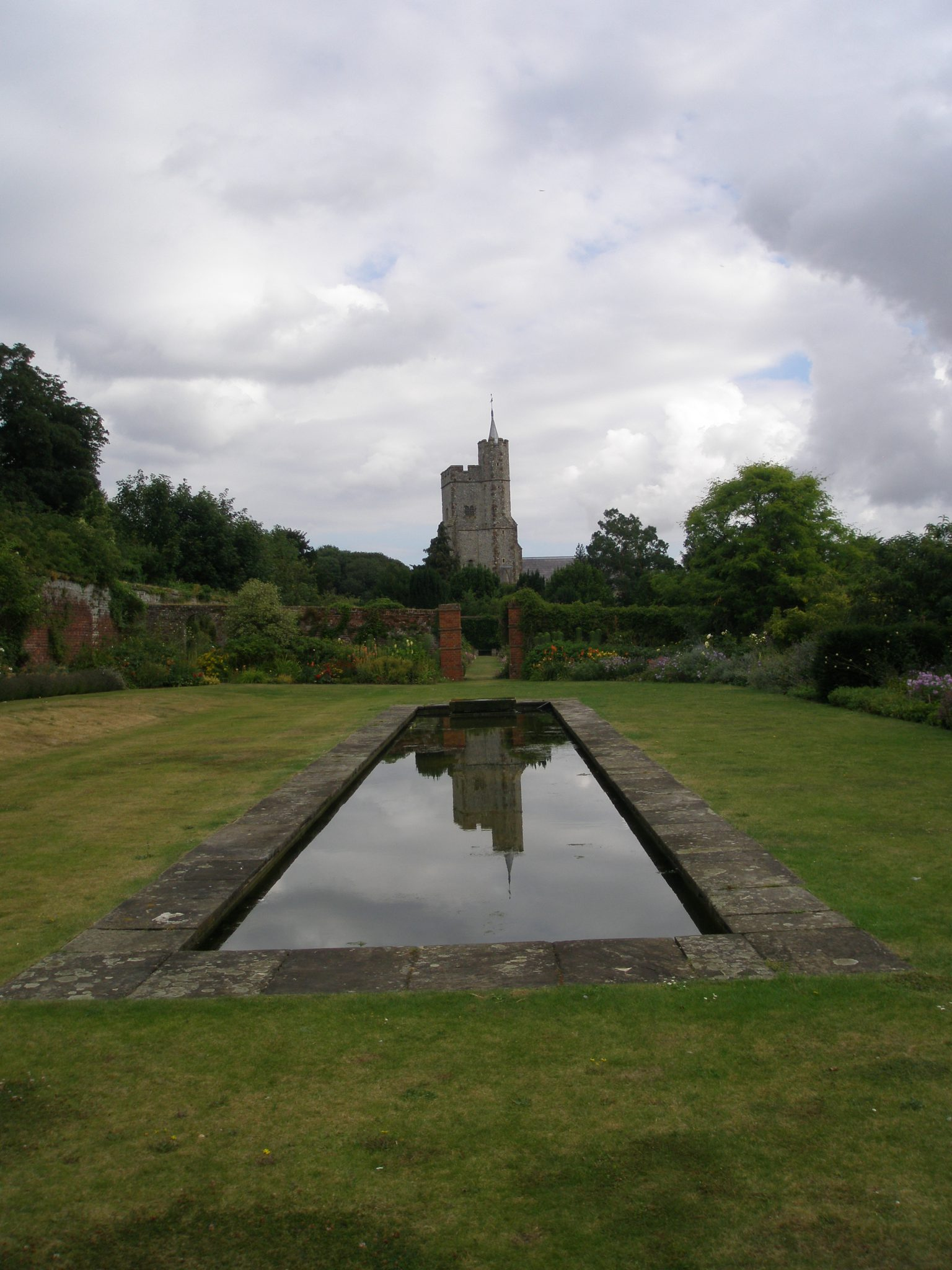 This central section of the Walled Garden is new: created in 2009, when old plantings were removed so that the ground could be leveled. After an 8-foot-slope had been flattened, a long, rectangular pool was placed in the center of the garden.
