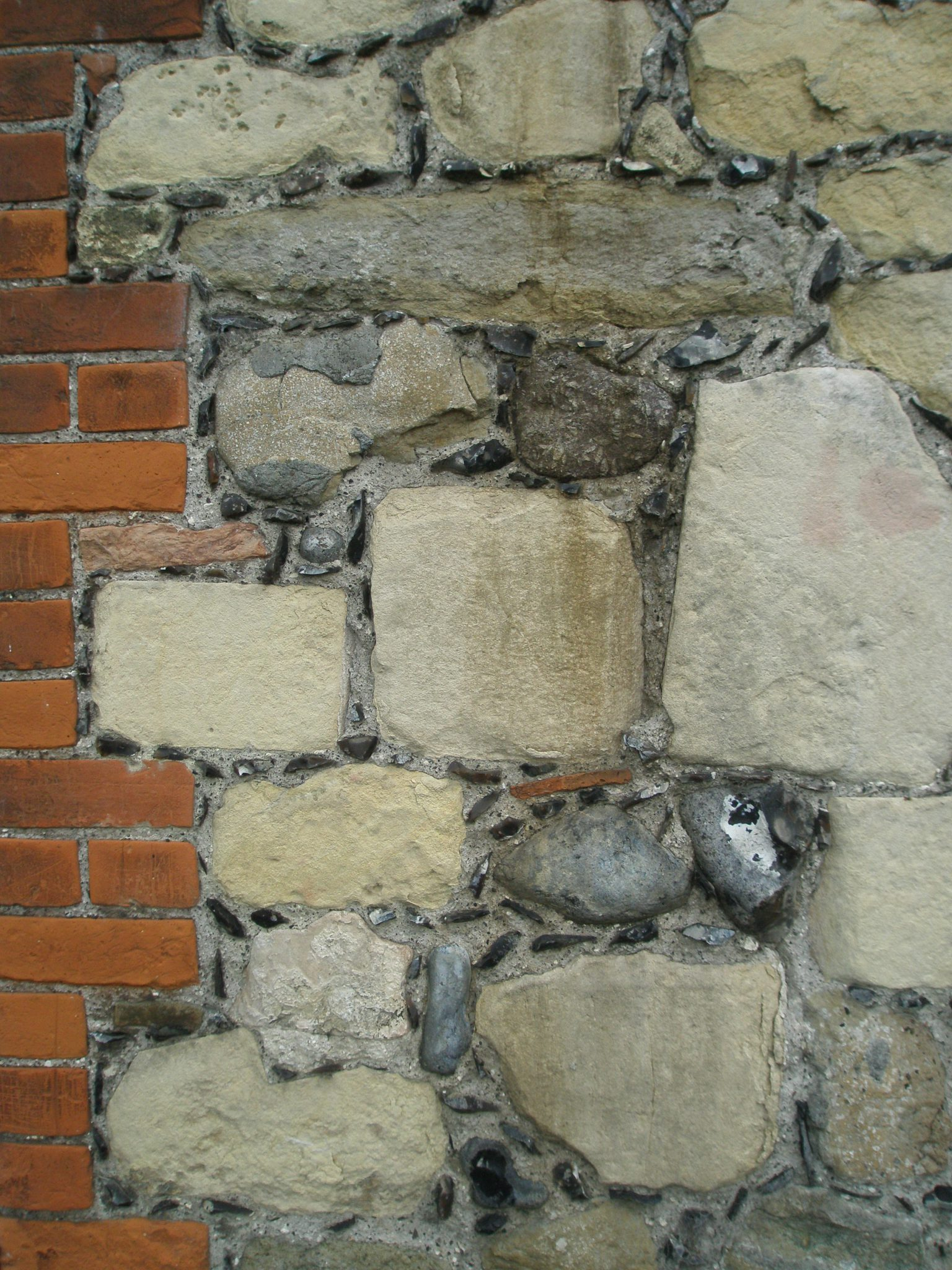 At the Main Entrance, I paused to admire yet another example of the Kentish-habit of combining brick, stone, and flint. This particular split-flint wall is GALETTED...so-called when those little black specks of rock are added, and used as spacers in the mortar.
