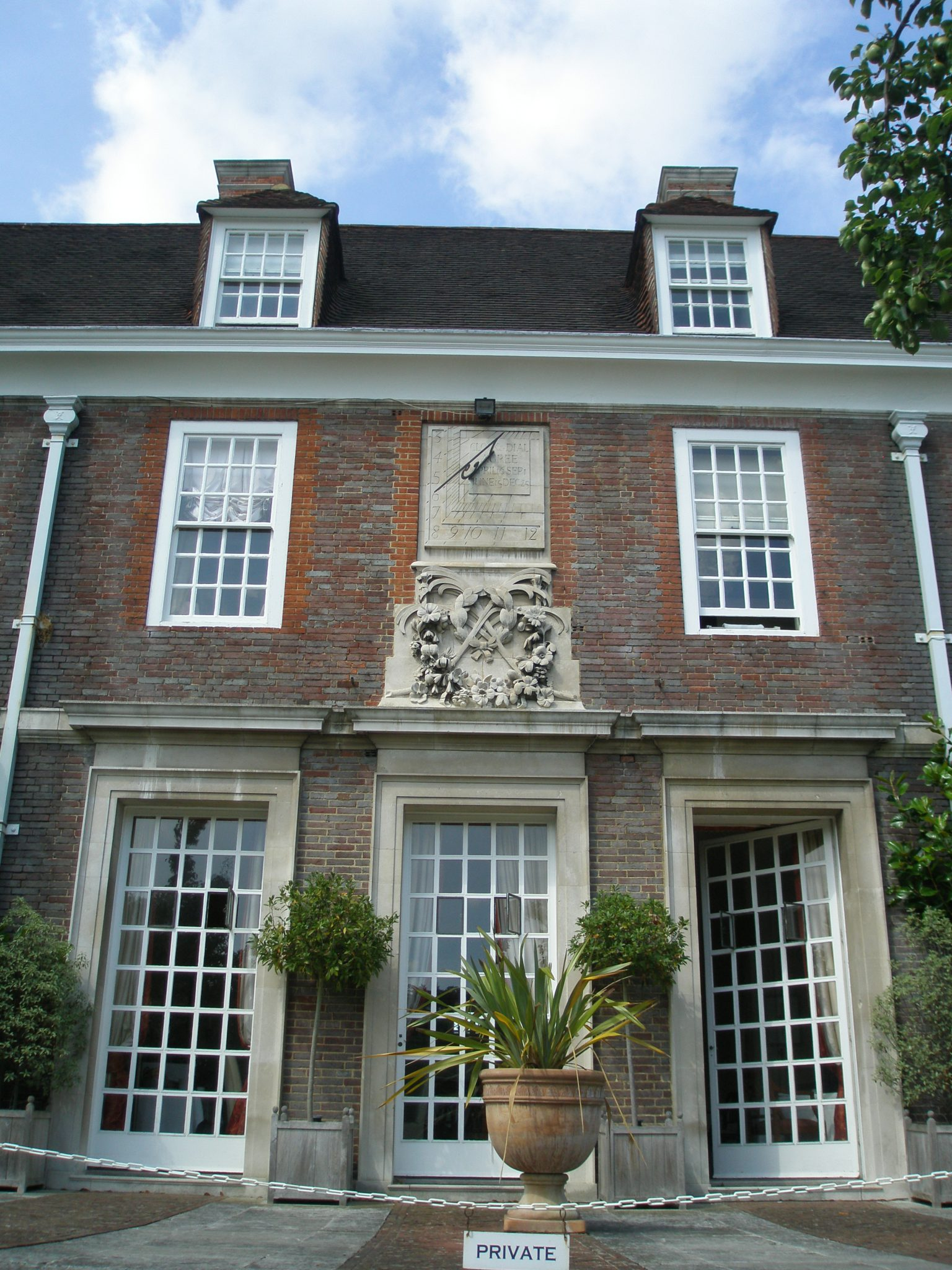 The House, at the Main Terrace. Note the gorgeous sundial, over the carved decoration.