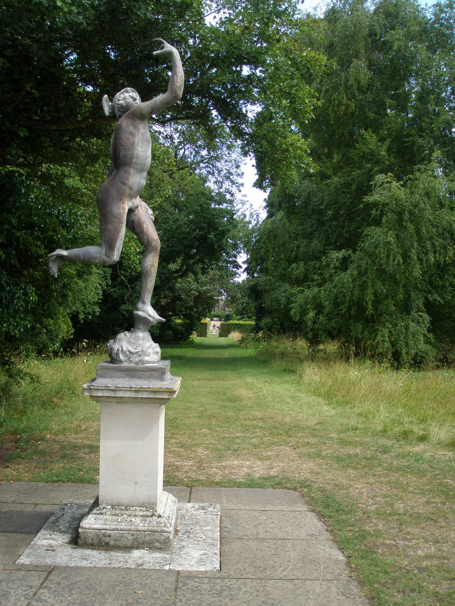 Beyond the Upper Terrace, this statue of Hermes welcomes visitors to the wild ramble of the Garden's Paddock-area.
