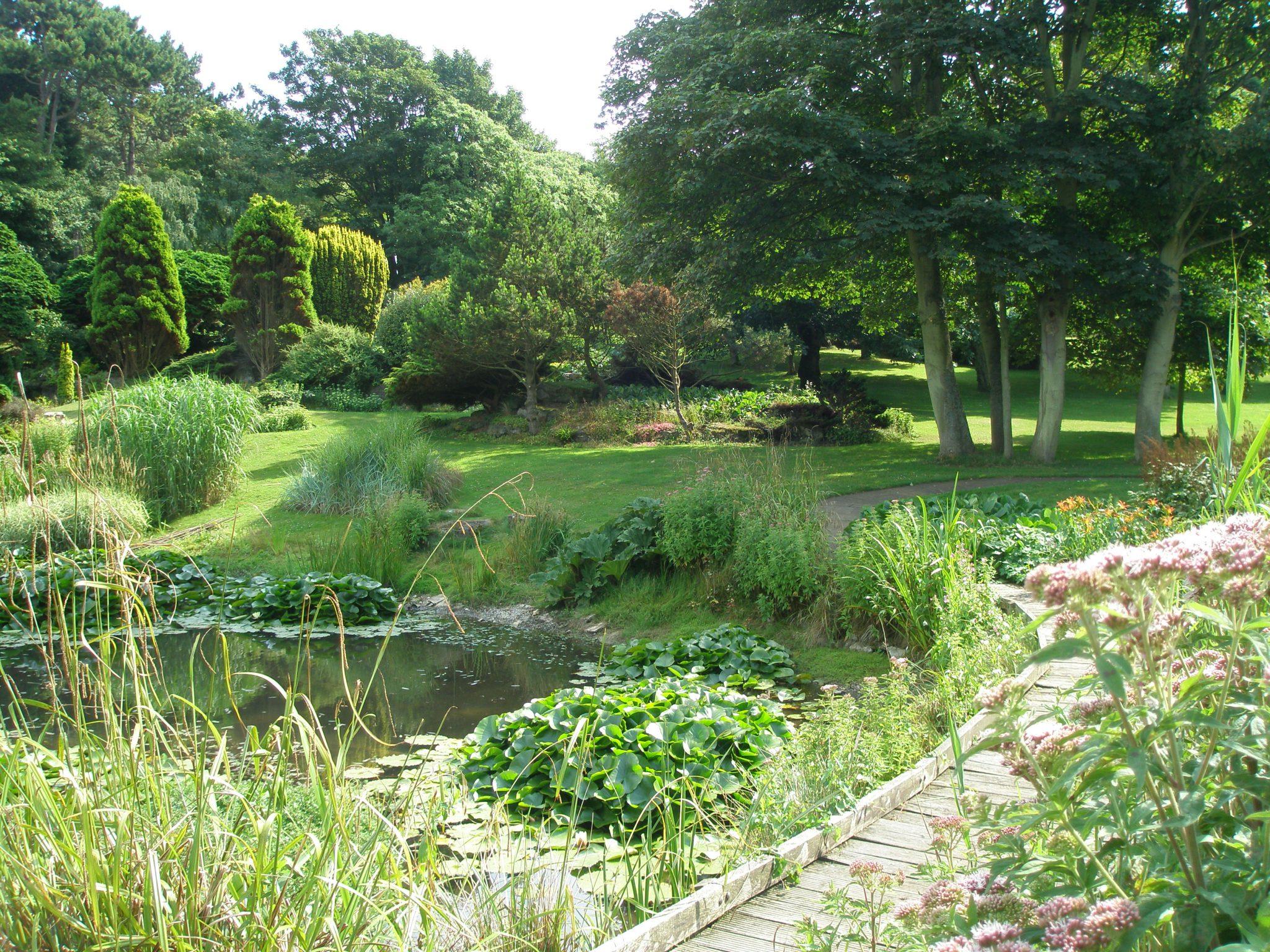 A bridge spans the pond.