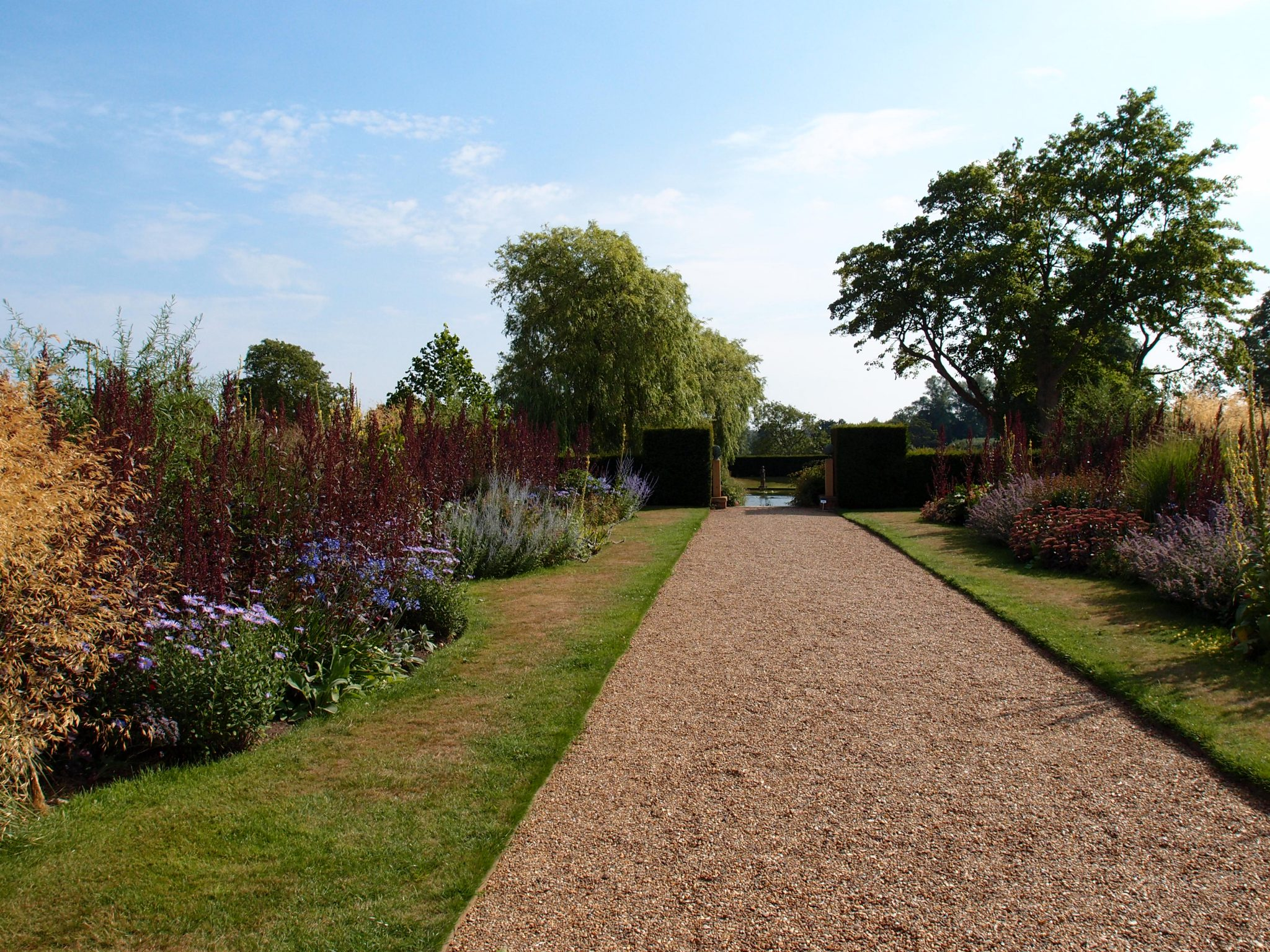 From the Croquet Lawn, we proceeded south, on the Herbaceous Border path. The Lily Pond shimmers, in the distance.