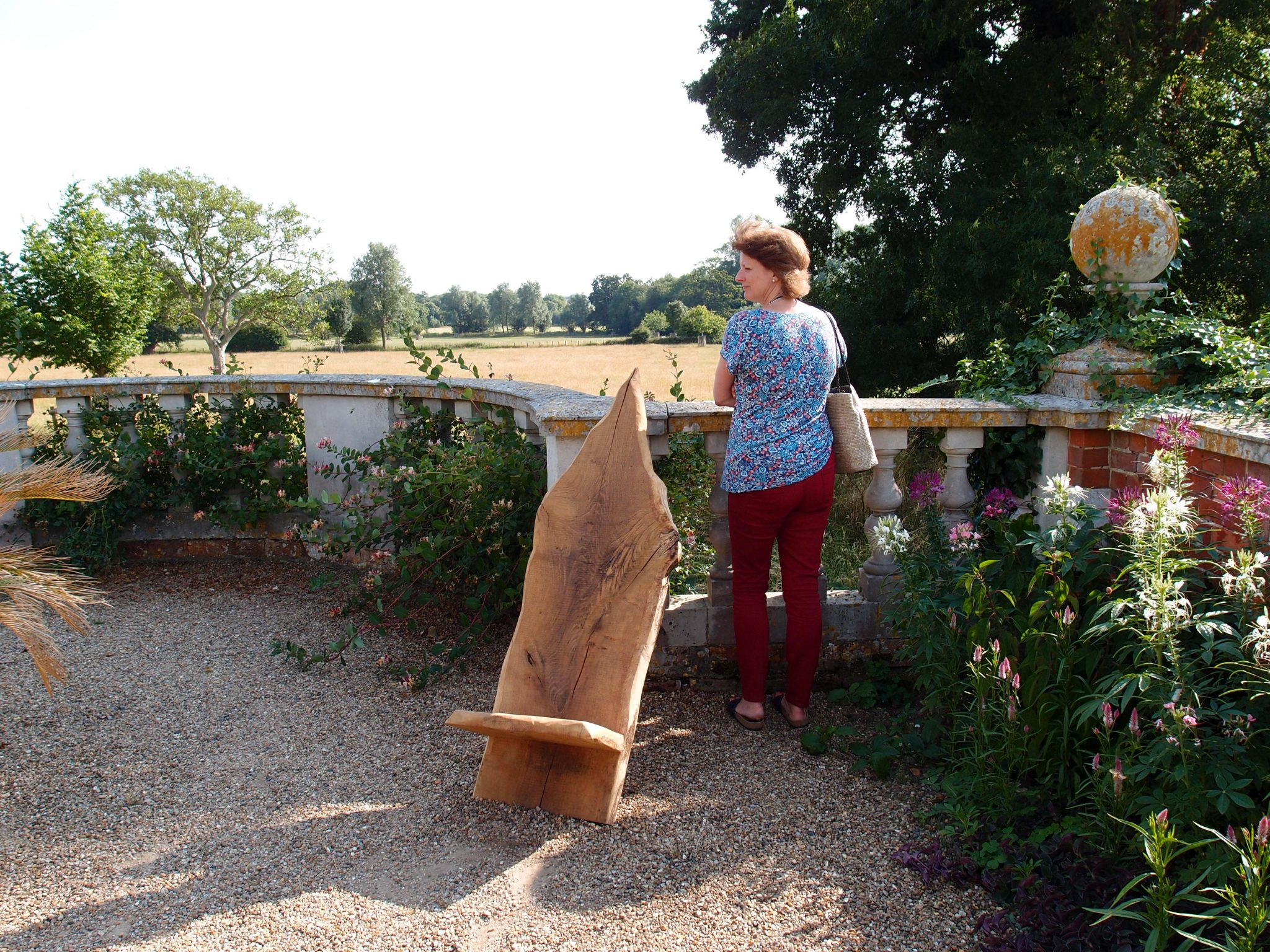 Free-form Wooden Chairs look right at home on the Belvedere. Amanda enjoys the afternoon's warm breeze.