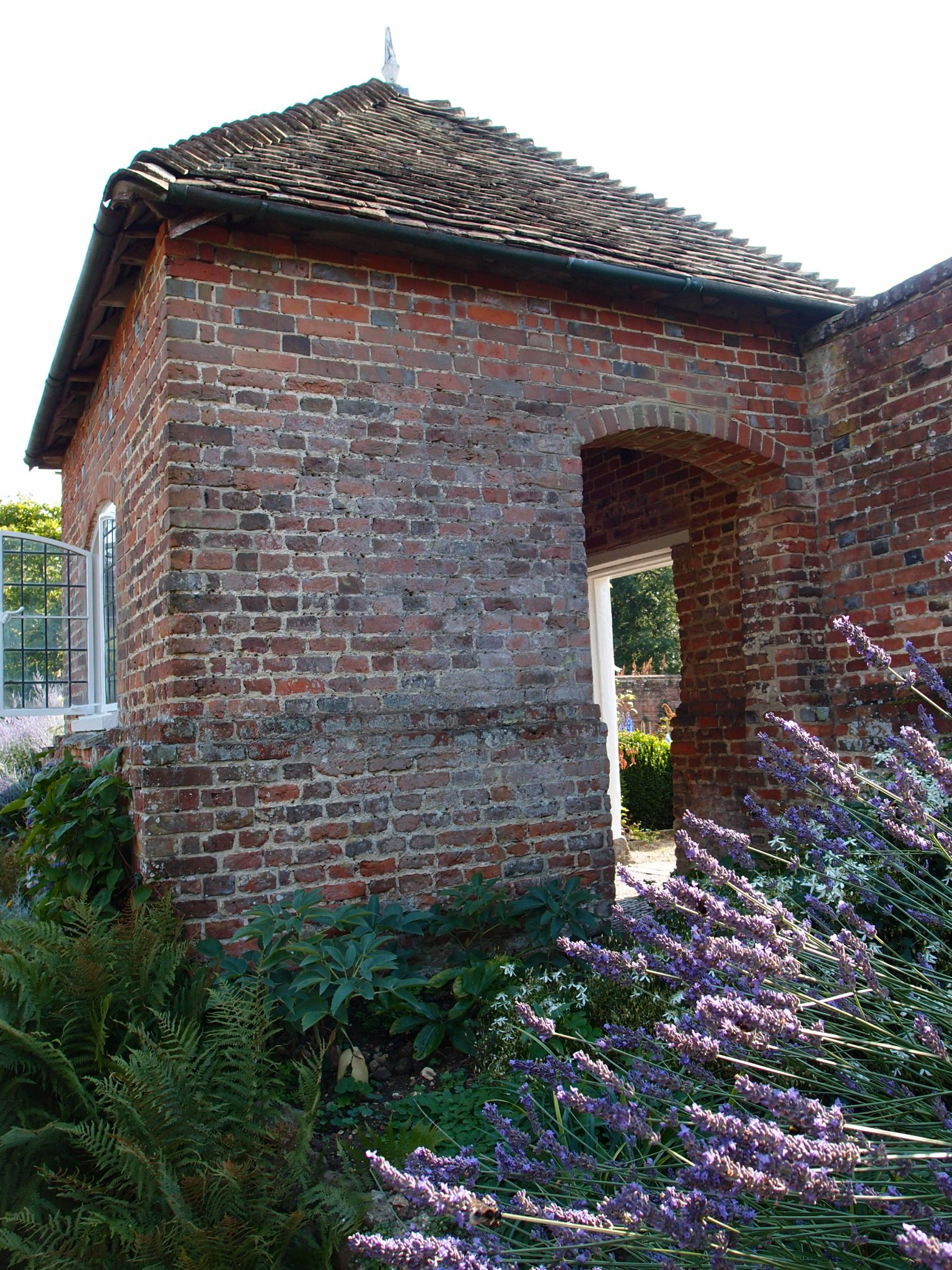 The late 18th century Walled Garden can be discreetly entered through this brick gazebo that's next to the center of the Rill in the Italian Garden.