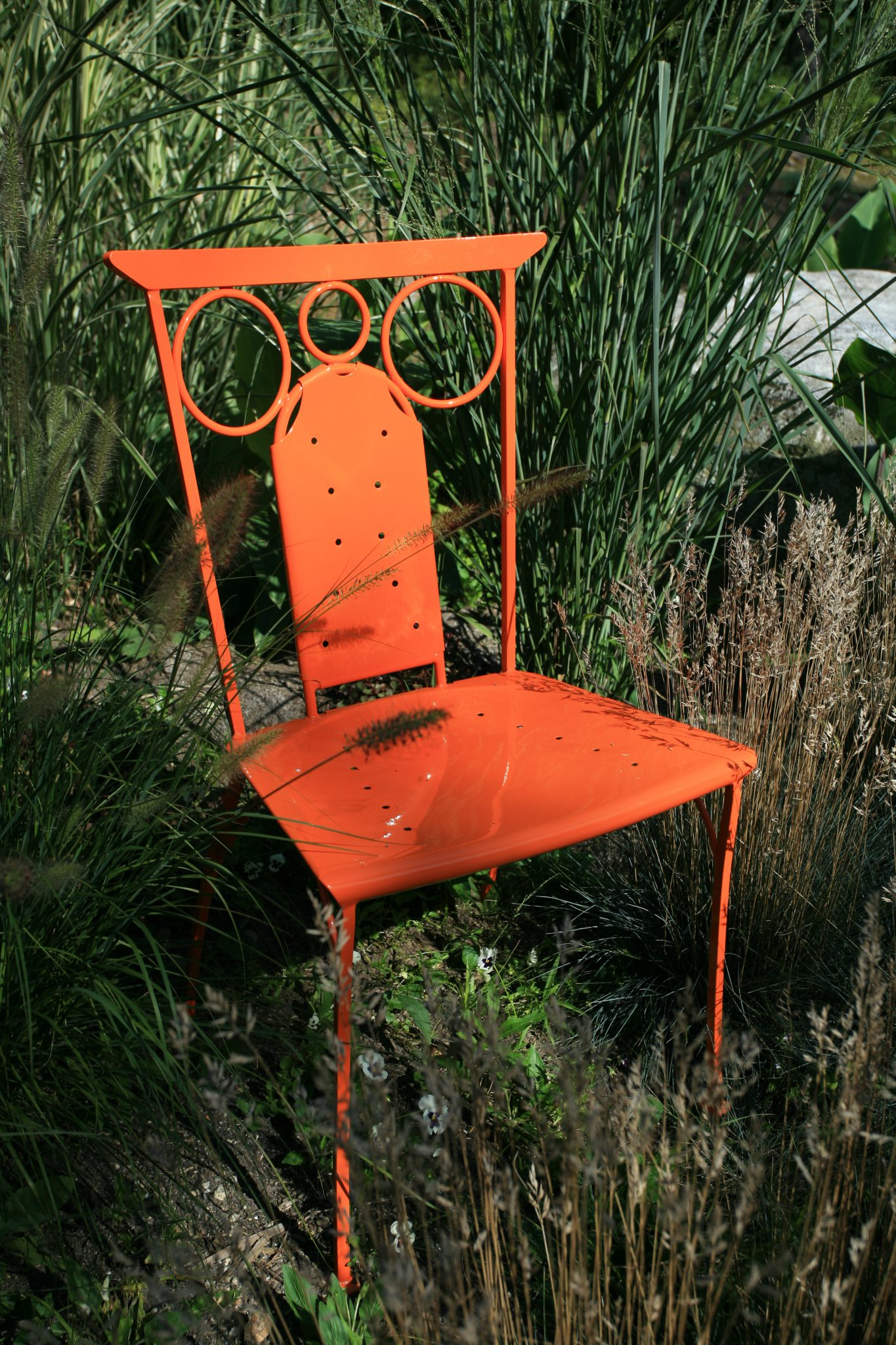 My Lorenzo Side Chair, powder coated in Bright Orange.