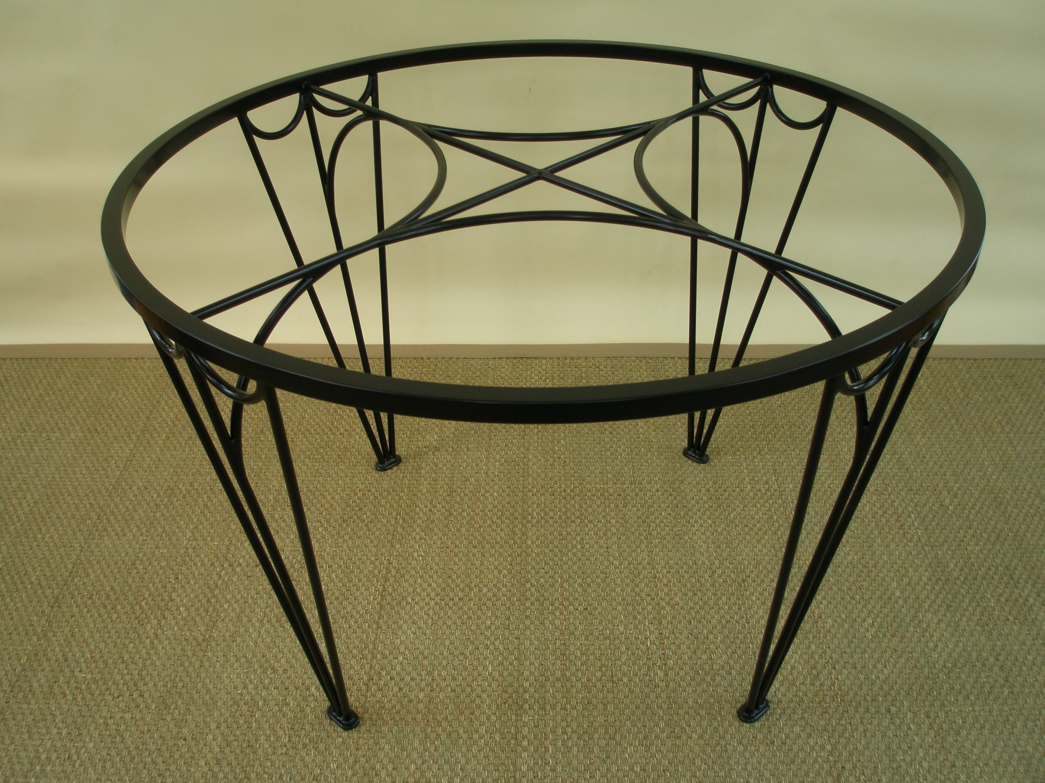 My glass-topped Tiara Dining Table, powder coated in Black Velvet.
