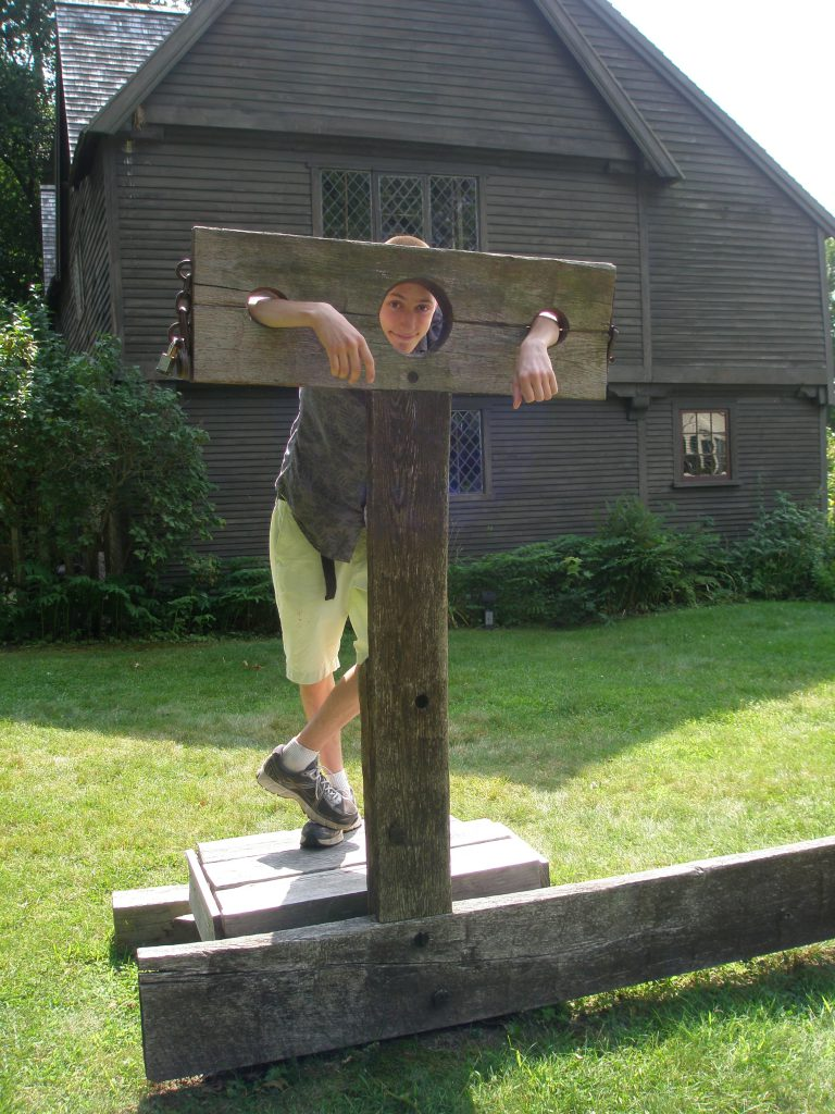 On the lawn of the Whipple House, my nephew Leo Quick demonstrated proper use of the stocks, during our August 16th visit to Ipswich.