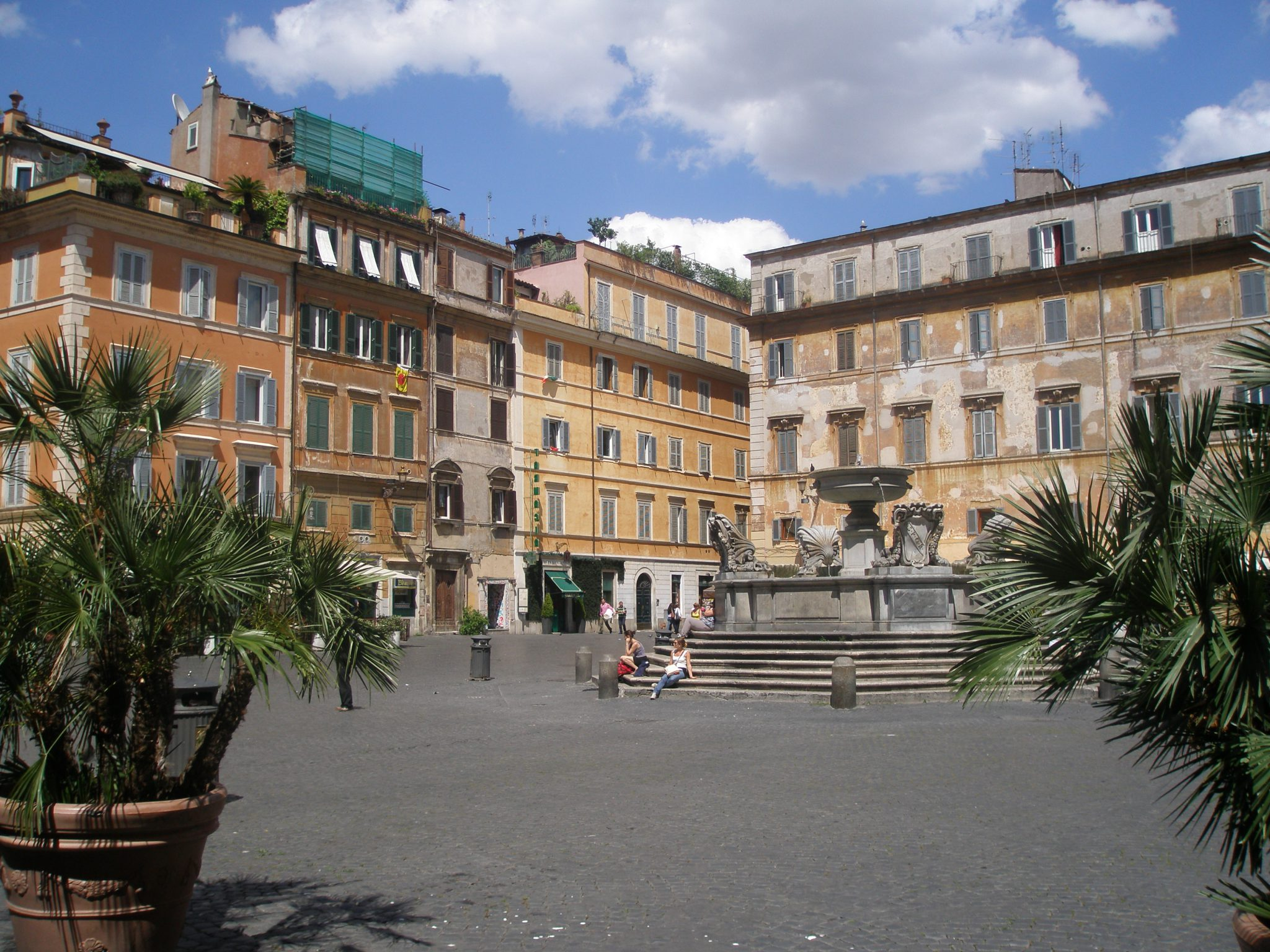 My favorite Farmacia in Trastevere is on the Piazza di Santa Maria, across from the Basilica. The entrance to the pharmacy is under the little green canopy that's in the center of this picture, to the rear of the fountain.