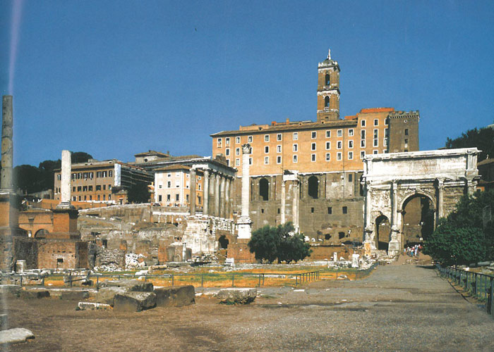 Today's view of the Square of the Roman Forum. The building that looms in the background is composed to two parts. The arched Gallery is that of the Tabularium, where I stood to take my introductory Forum photos. The three floors with evenly-spaced windows that are above the Gallery were added when Michelangelo's Palazzo Senatorio was built. Image courtesy of R.A.Staccioli's ROME:PAST&PRESENT.