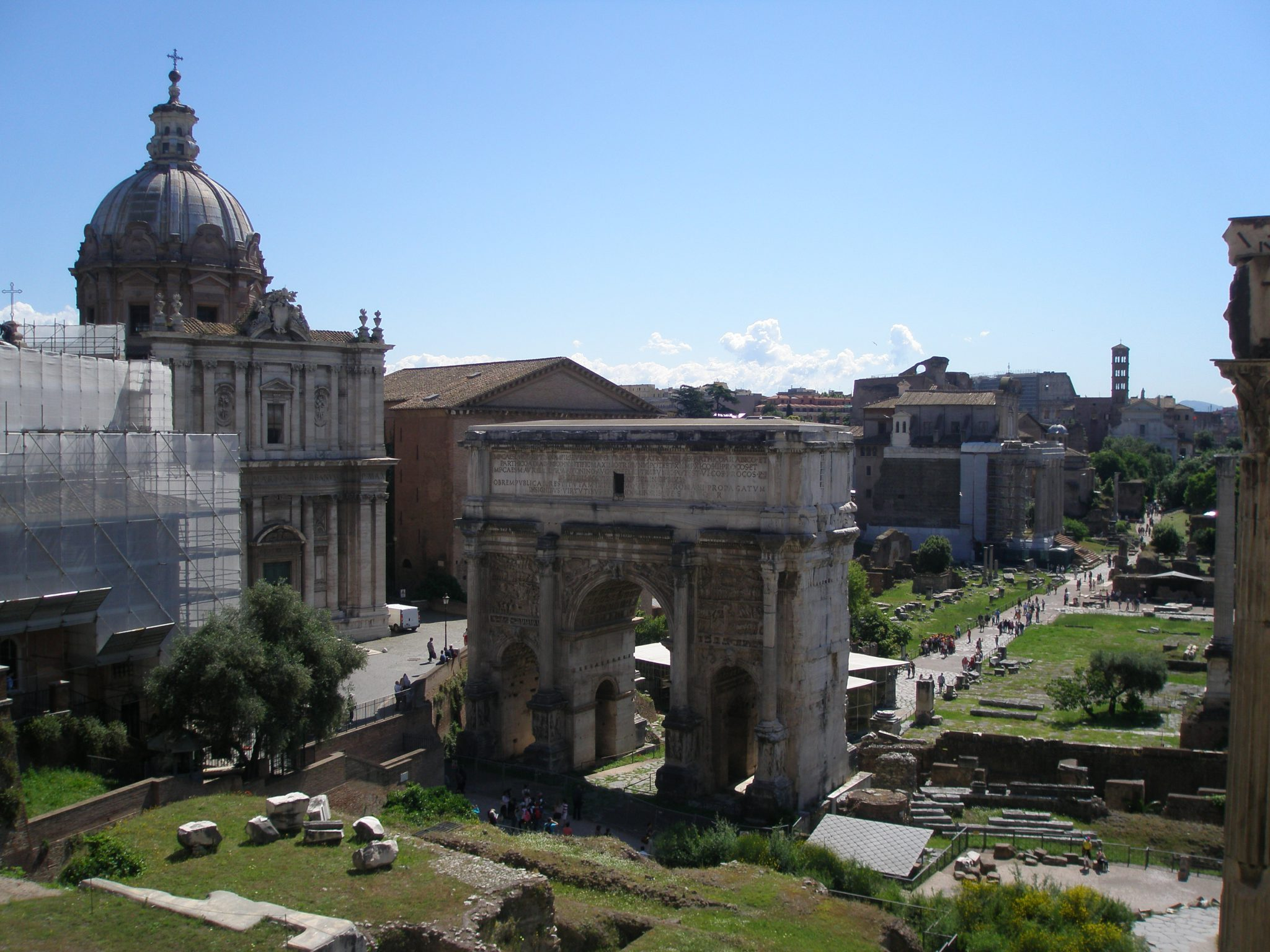 Upon entering the Tabularium's Gallery, this is one's first view of the Roman Forum: The Arch of Septimus Severus(Arco di Settimio Severo), erected by the Senate & People of Rome in 202AD. To the far left: the imposing dome of the Church of Santi Luca e Martina, which is not part of the Forum. A church has occupied this site since 228AD, but the current building is relatively modern...with construction that was begun in 1635.