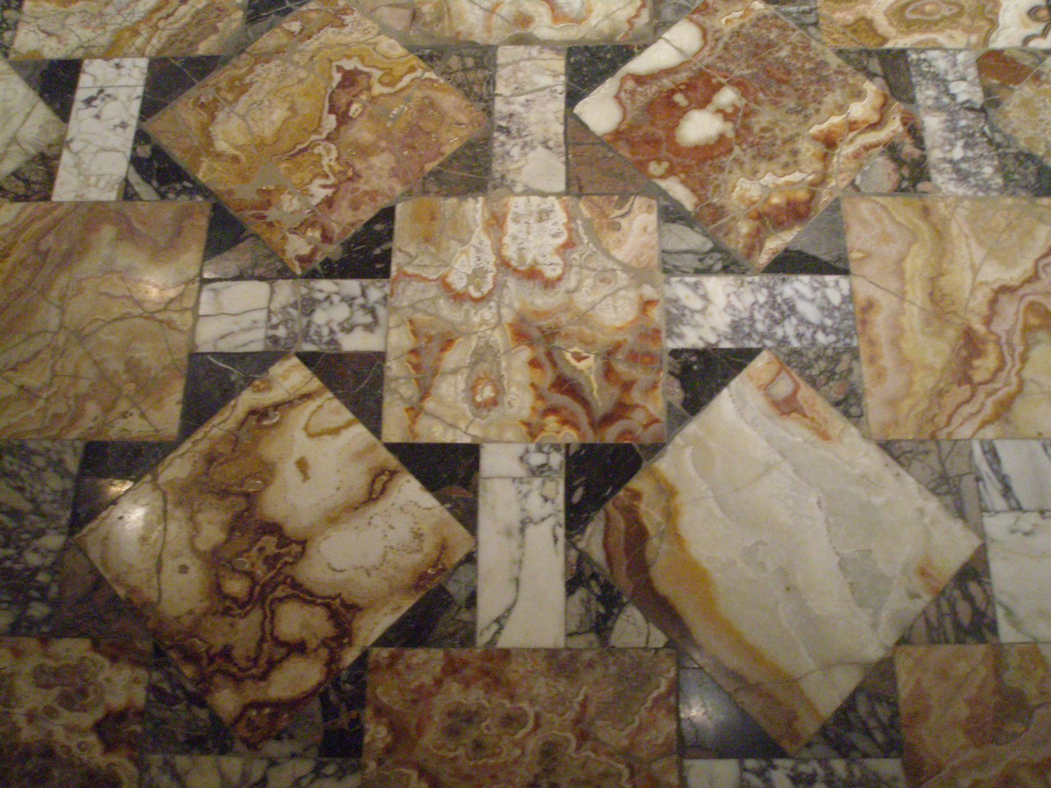 Displayed in the Palazzo dei Conservatori's Halls of the Horti Lamaini: A section of the di Palombara alabaster floor, from a Roman villa dated 3 AD. The fragment comes from a floor that was reputed to measure 79 meters long.