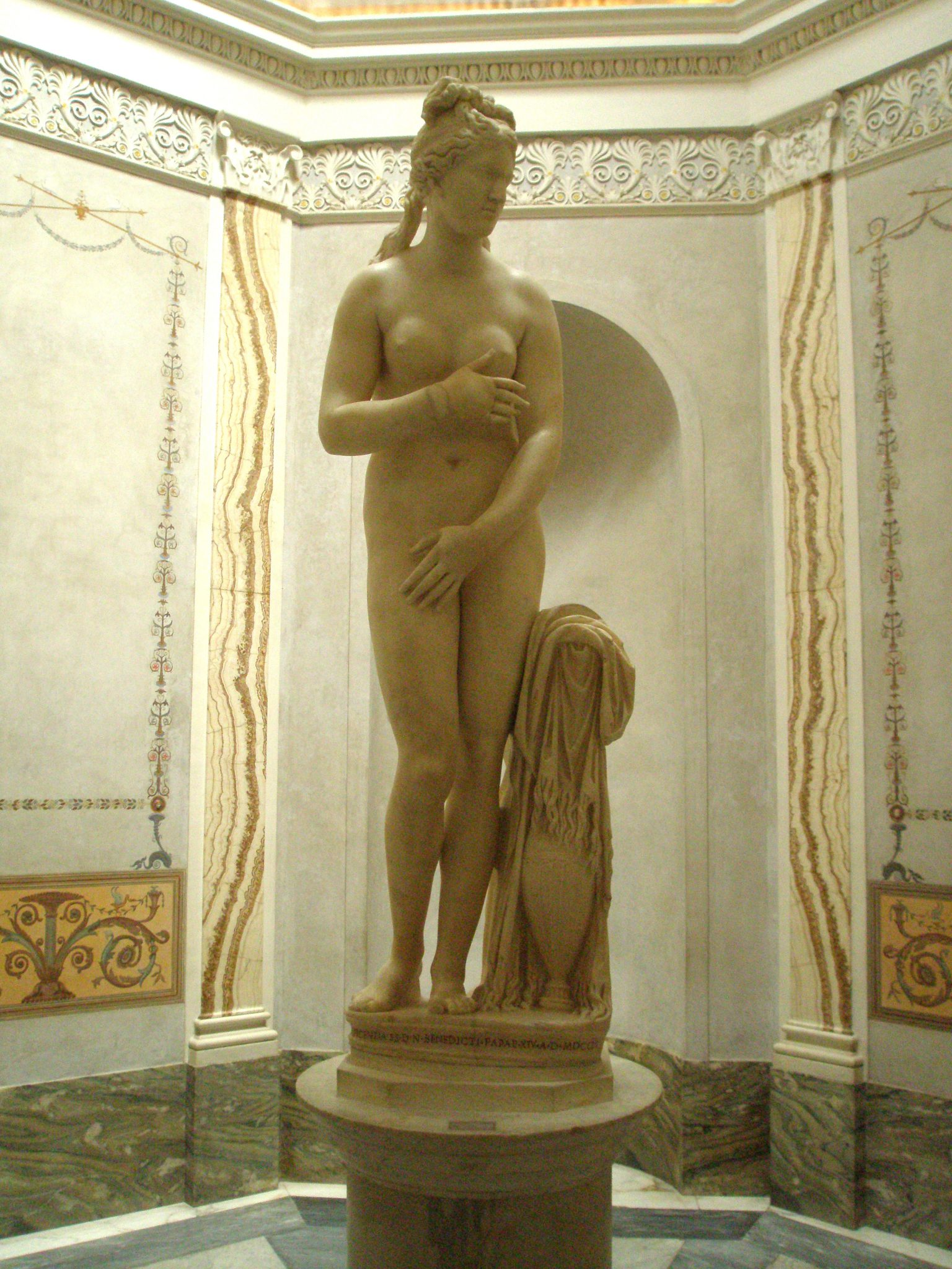 The Capitoline Venus. This is a replica of the original by Praxiteles (who lived in the 4th century BC). This copy of Venus was found in Rome around 1666--1670, and it's assumed the statue was made between 96AD and 192AD.